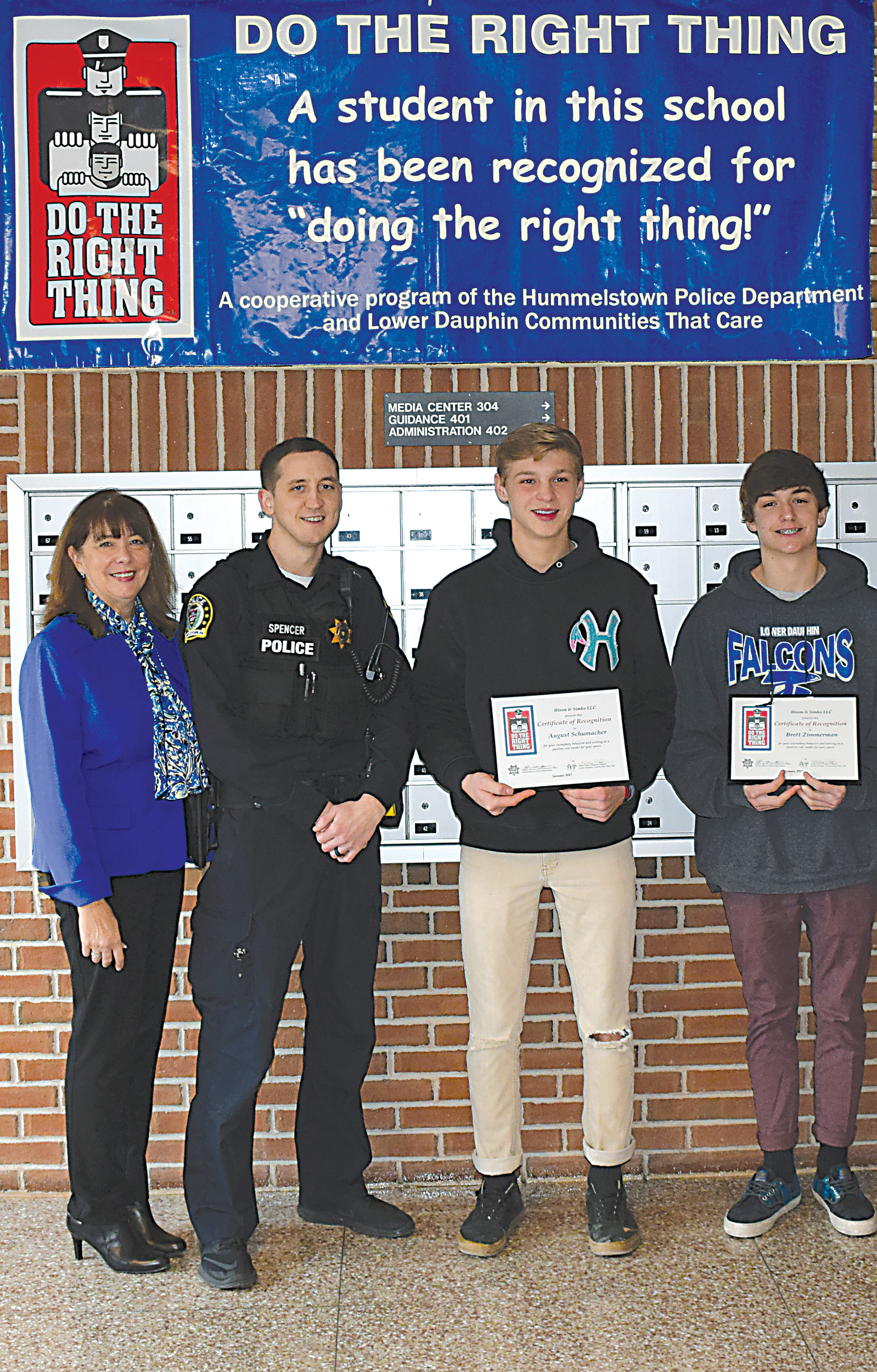 LD CTC's Kathy Peffer and SRO Eugene Spencer congratulate August Schumacher and Brett Zimmerman.
