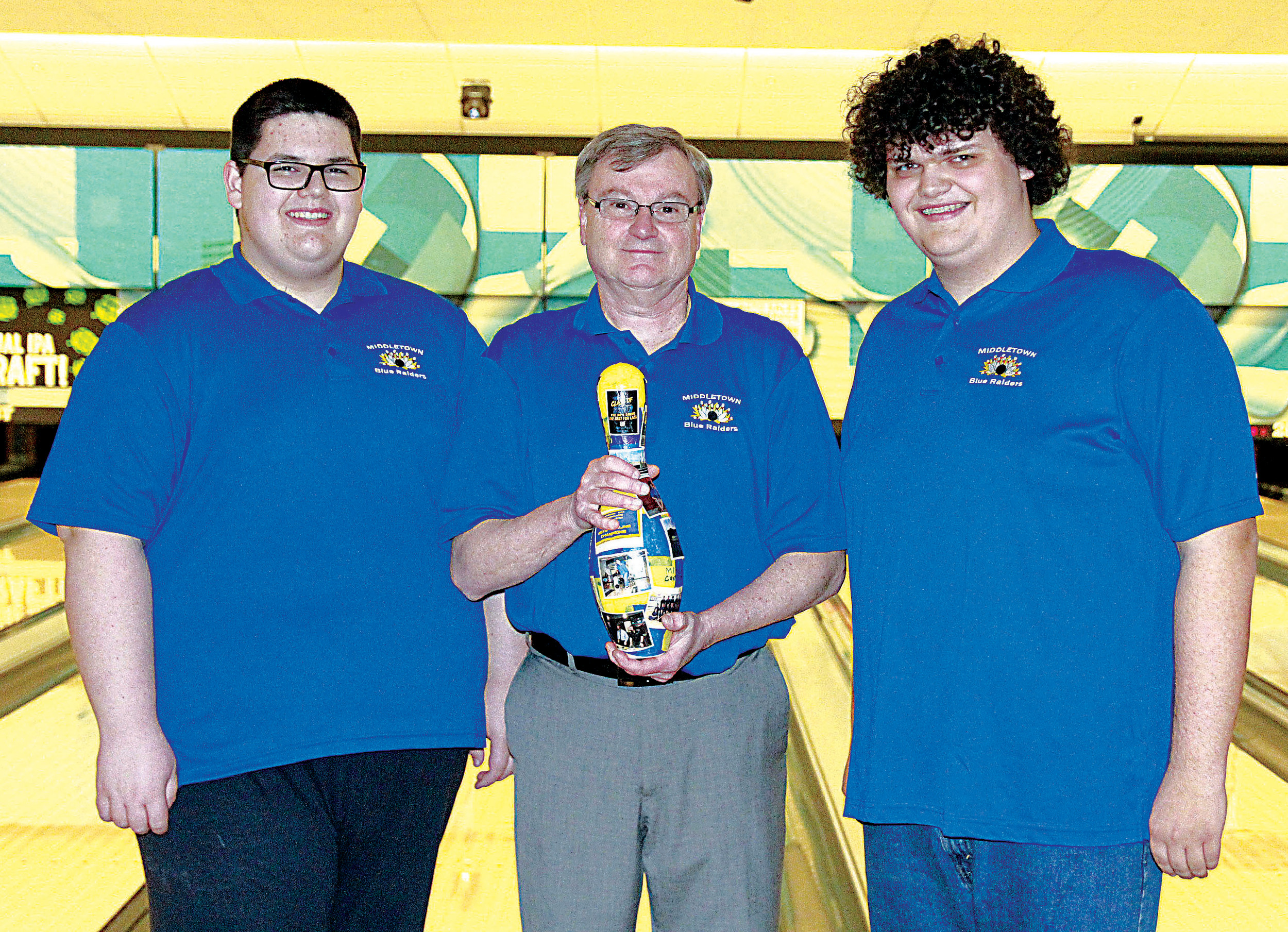 Caleb Orner, bowling coach Darrell Bower and Mitch Carson celebrate senior recognition day at ABC East Lanes on Feb. 23.
