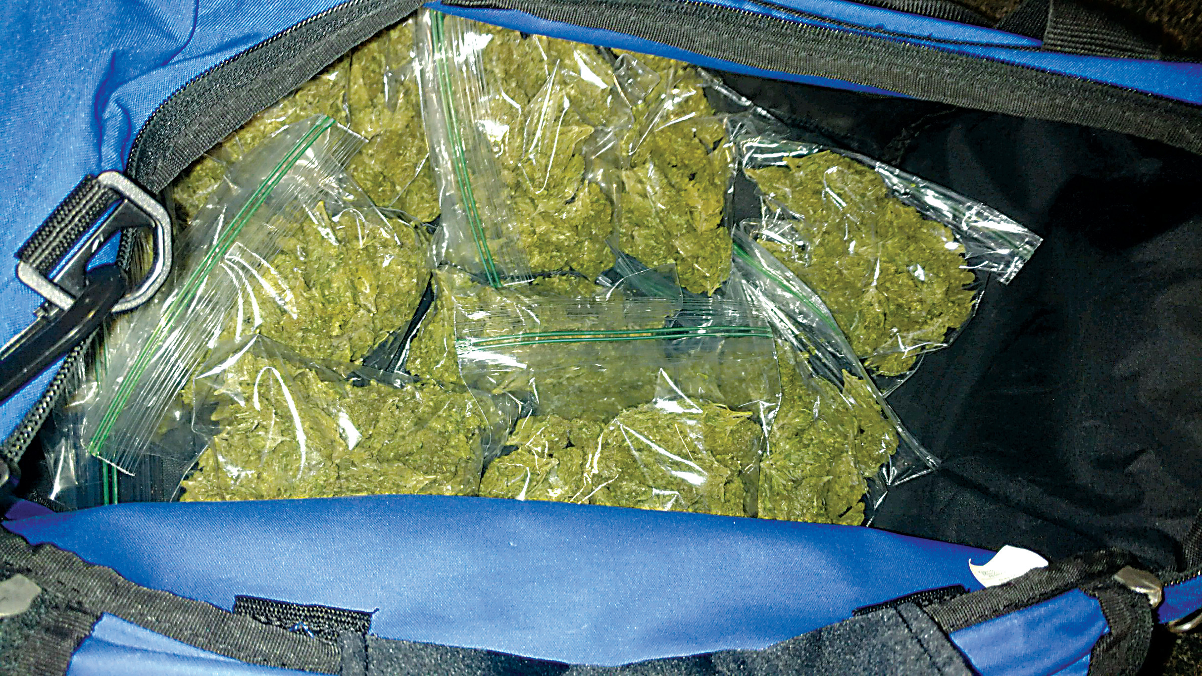 A duffle bag containing about a half pound of marijuana was recovered from a car parked at 7-11.