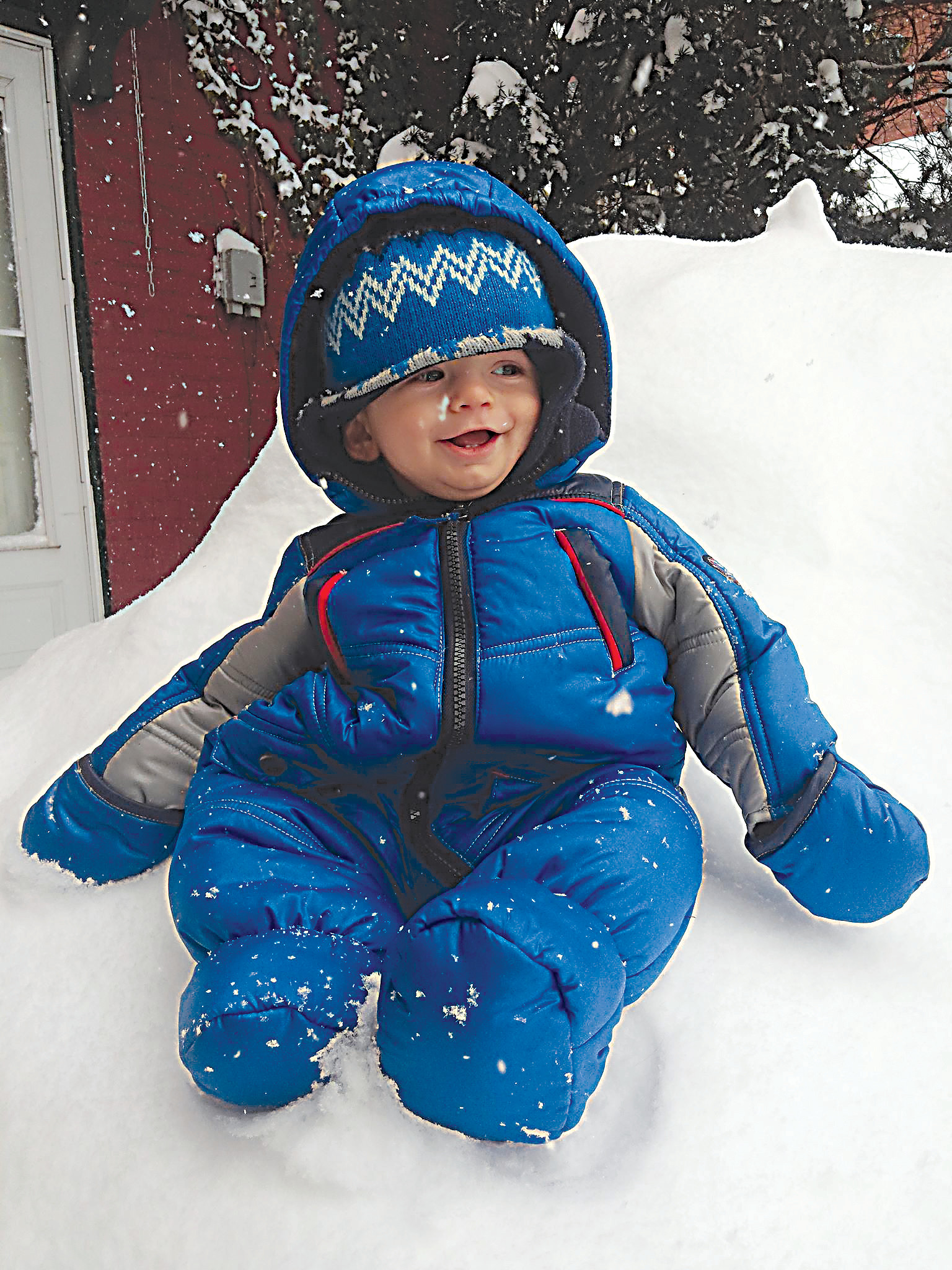 Axel Backenstoes, 9 months, enjoys his first snow storm in Middletown.