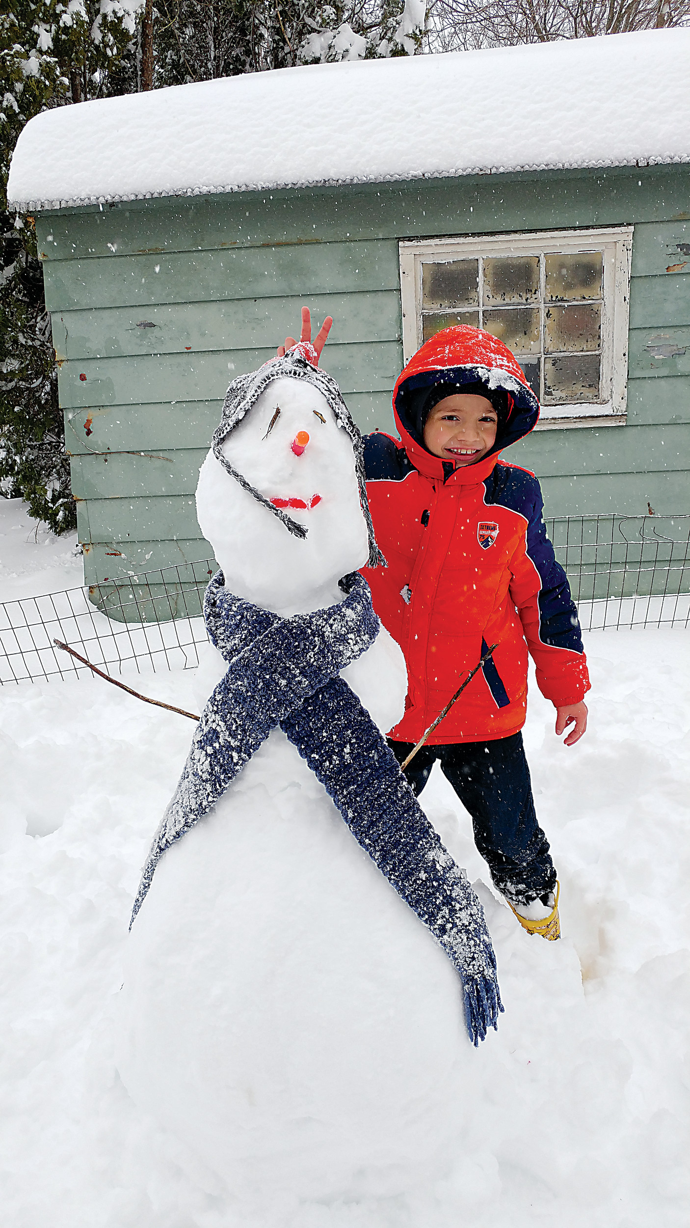 Aden Grogan, 8, and his snowman in Middletown.