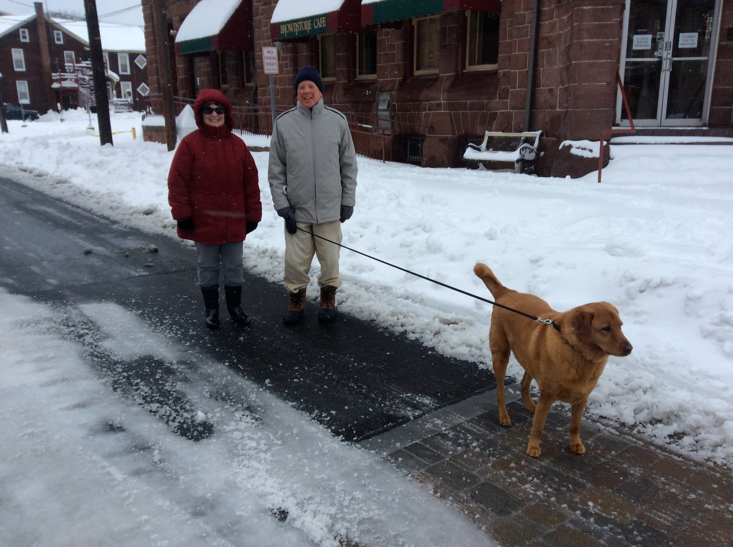 Karen and David Judy brave the snow after roads were started to be cleared Tuesday.