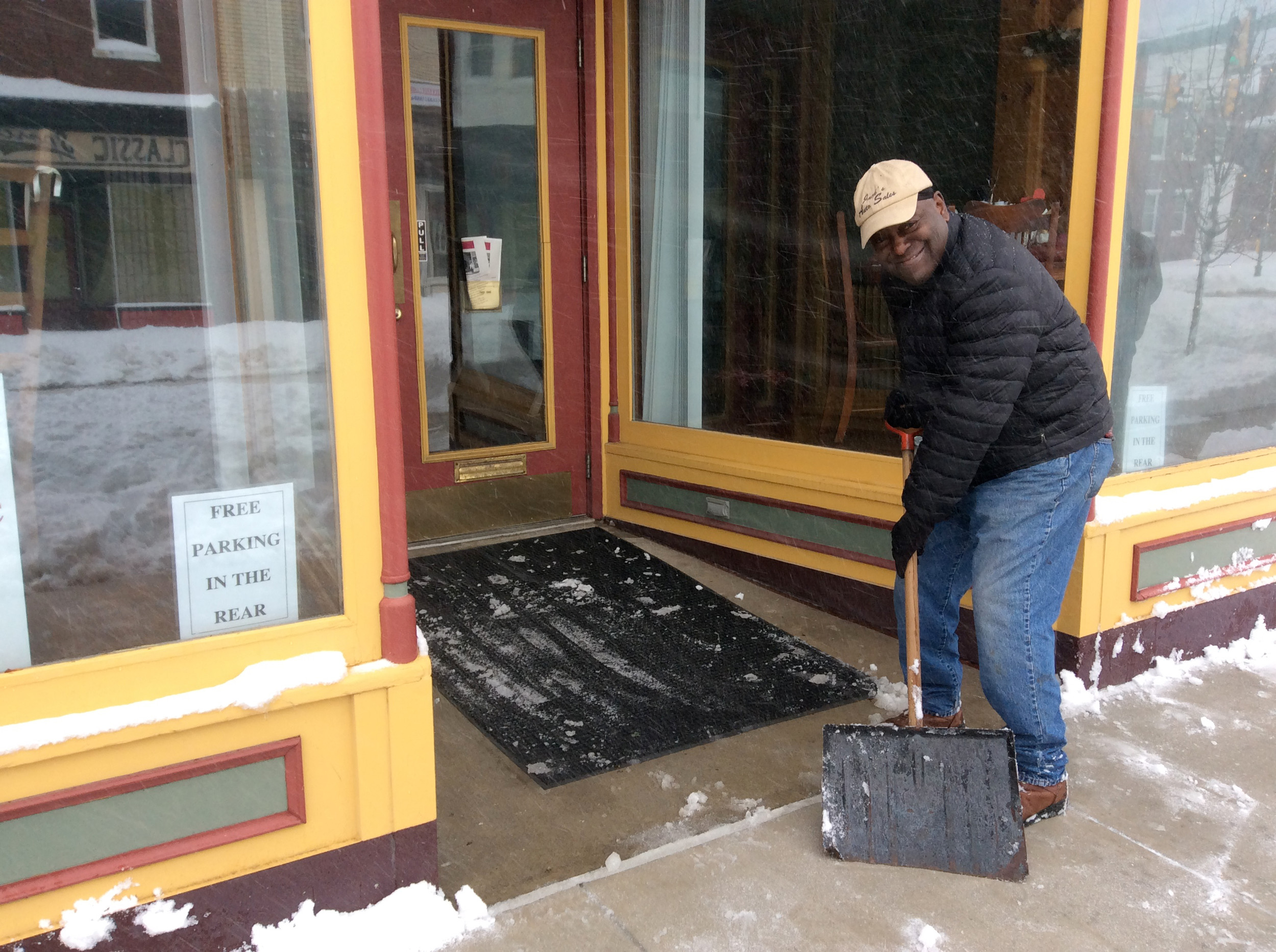 Phil Bennett shovels outside the Events Place