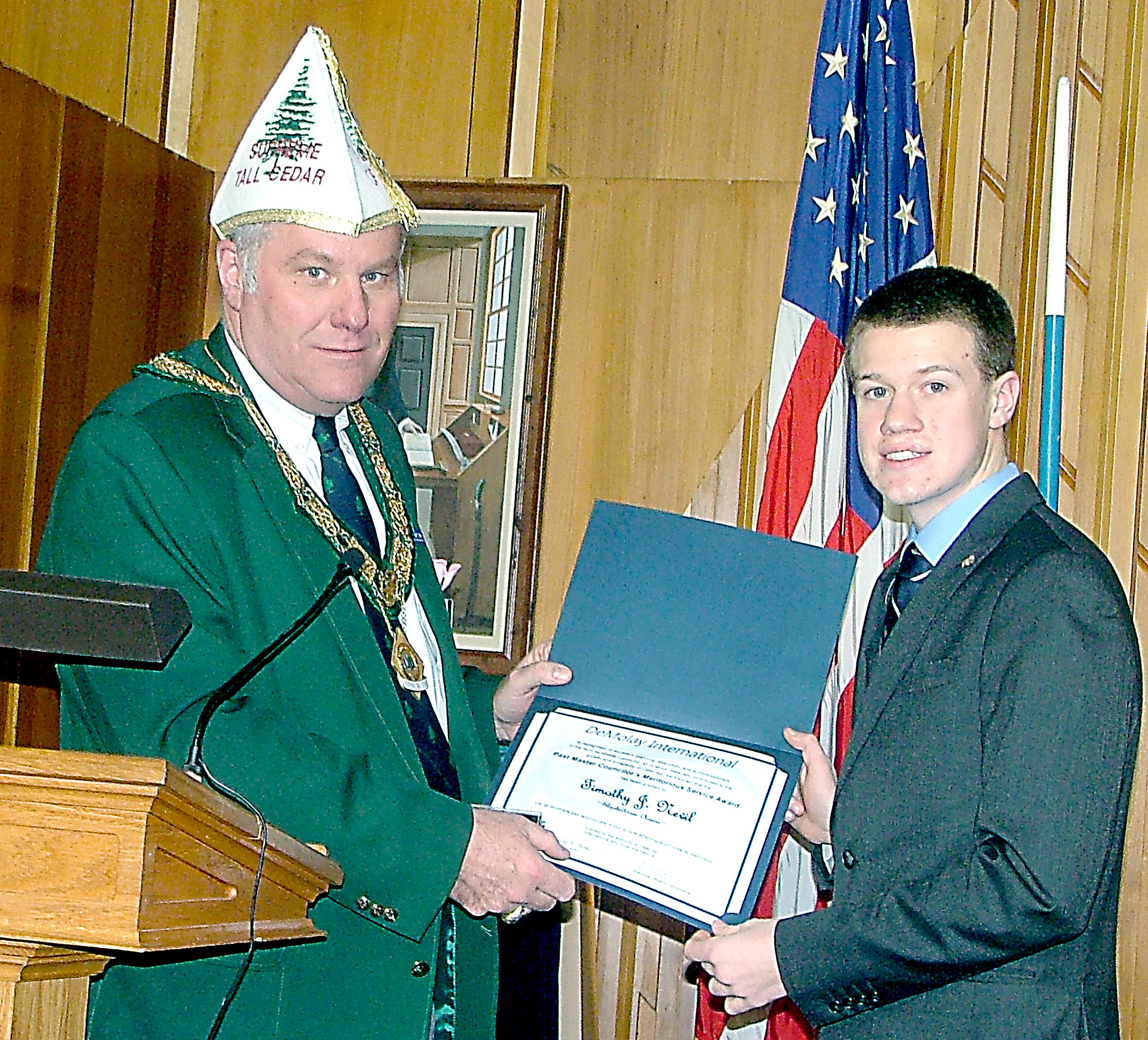 Supreme Tall Cedar Mark Brumaghim of Harrisburg presents the Past Master Councilor's Meritorious Service Award to Elizabethtown DeMolay's Past Master Councilor Timothy Nevil of Middletown.