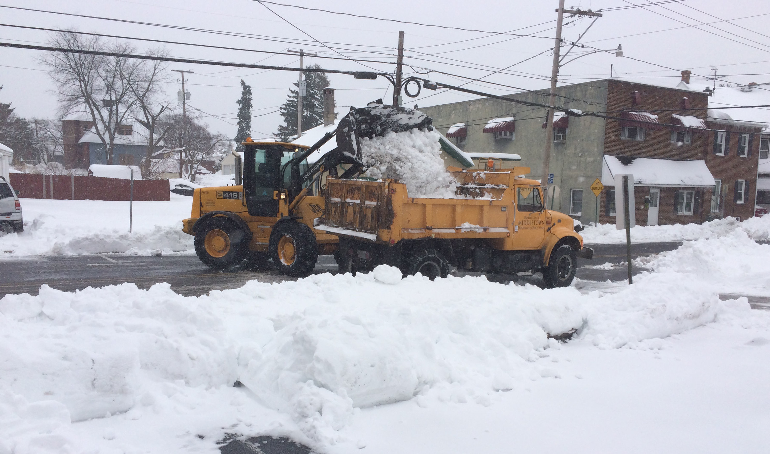 Middletown borough crews remove snow from the edge of the street along Emaus Street in this file photo.