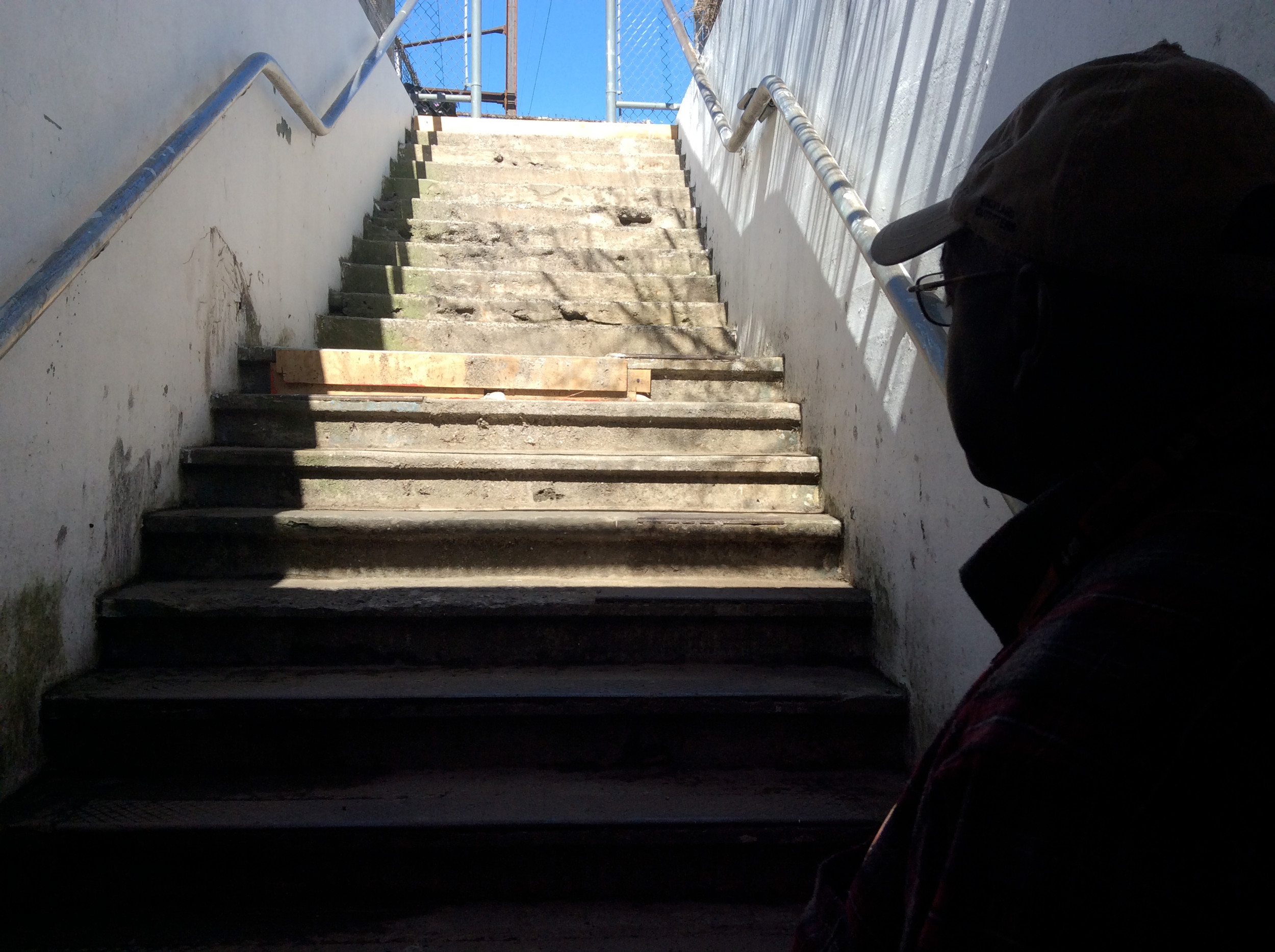 Phil Bennett looks up the stairs on the Karns side to see boards that have been attached to the steps.