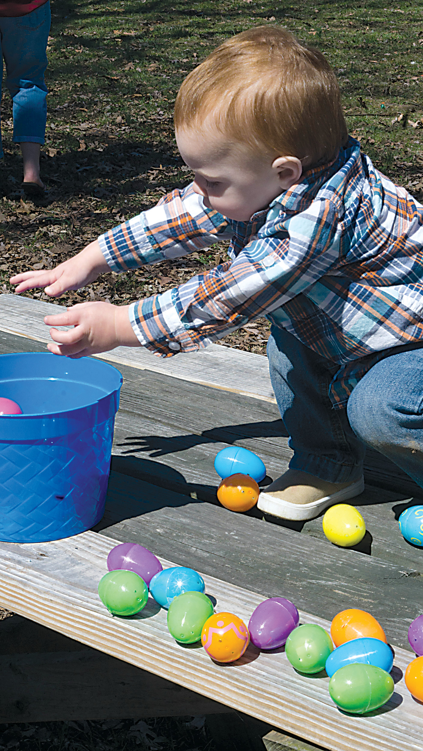 Landon Markle fills his bucket with eggs after taking them out to count them