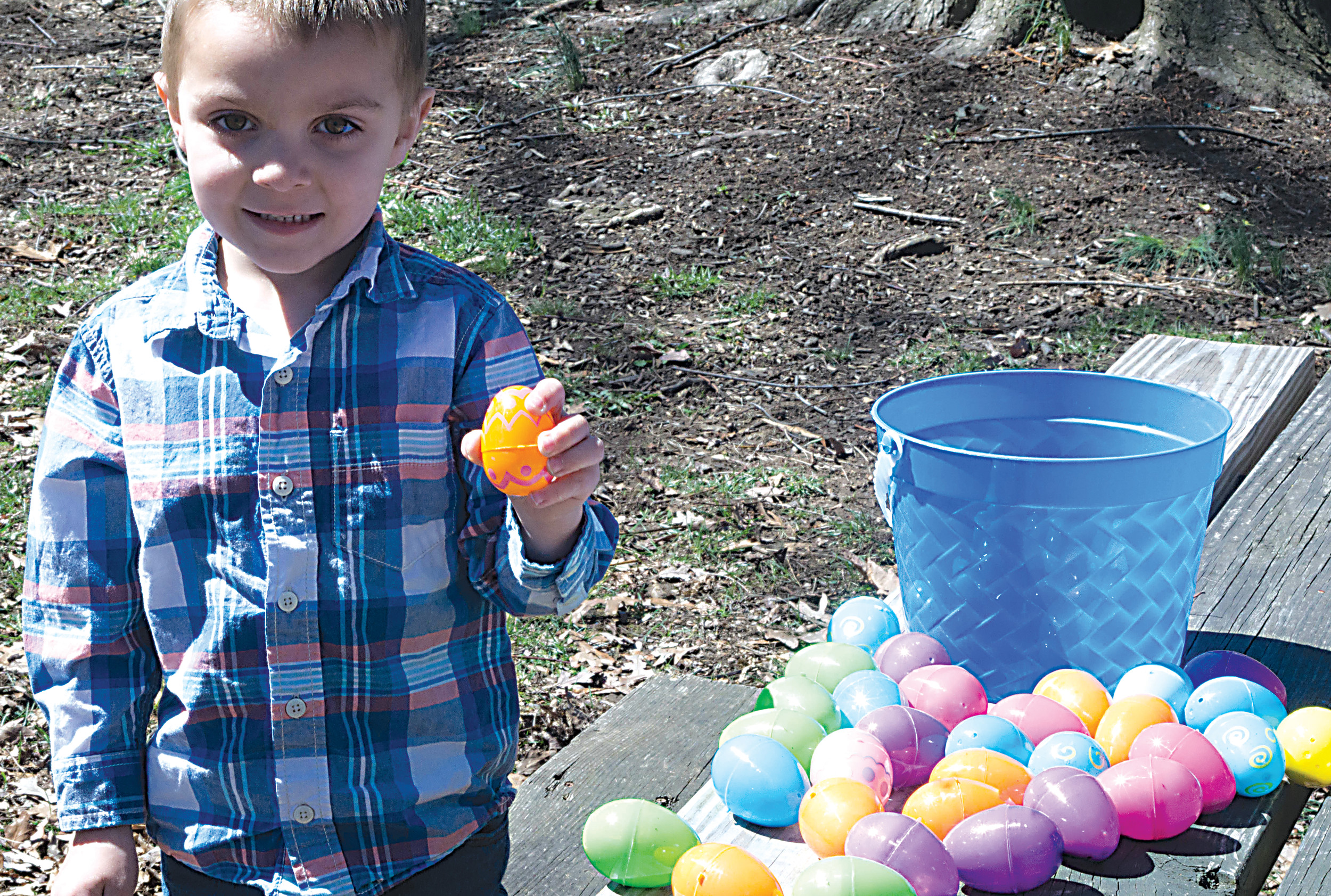 Kayden Markle holds up the eggs that he and his brother Landon found during the police easter egg hunt