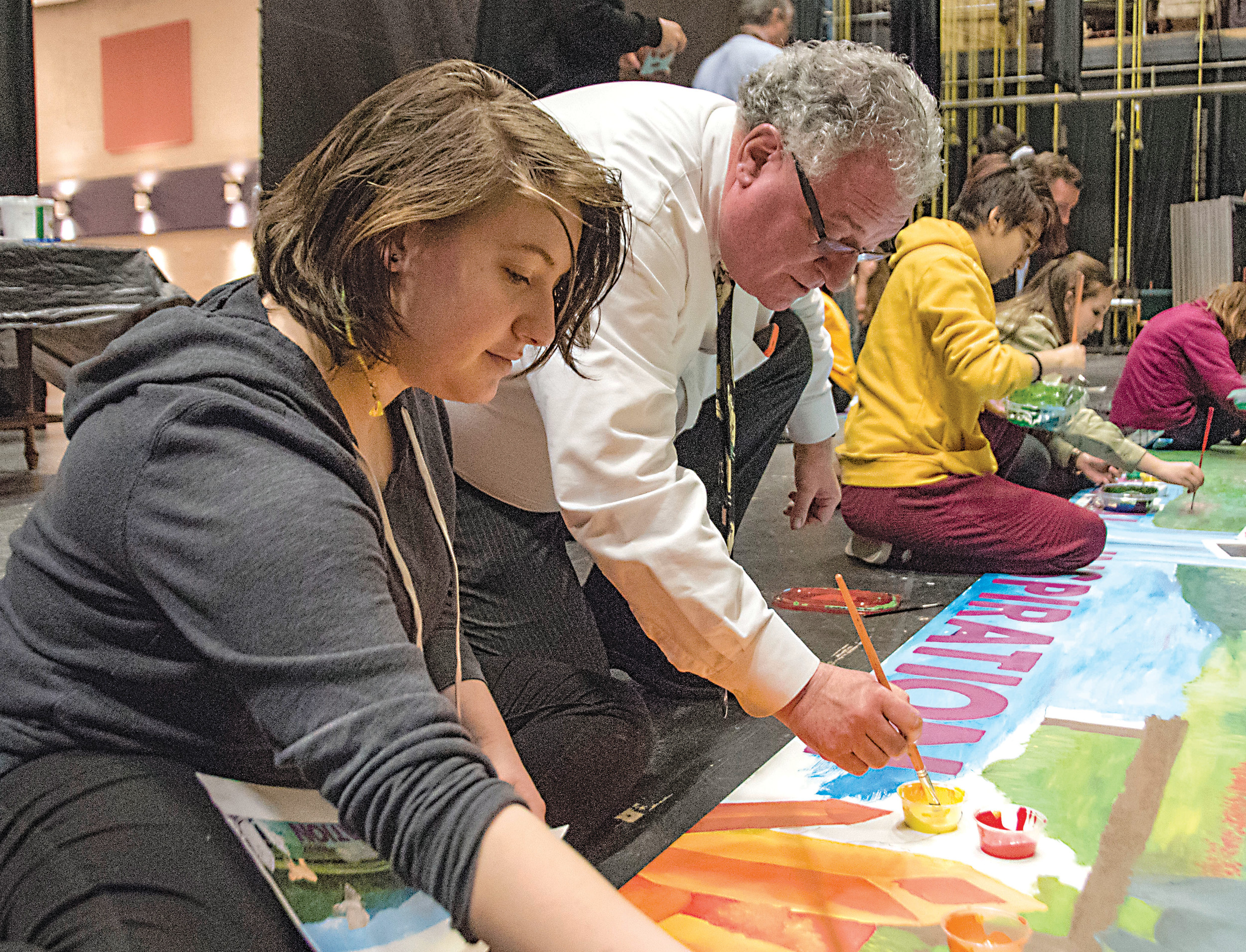 Phillip Horn, executive director of the Pennsylvania Council for the Arts, works with a young artist at Lower Dauphin High School on March 30.