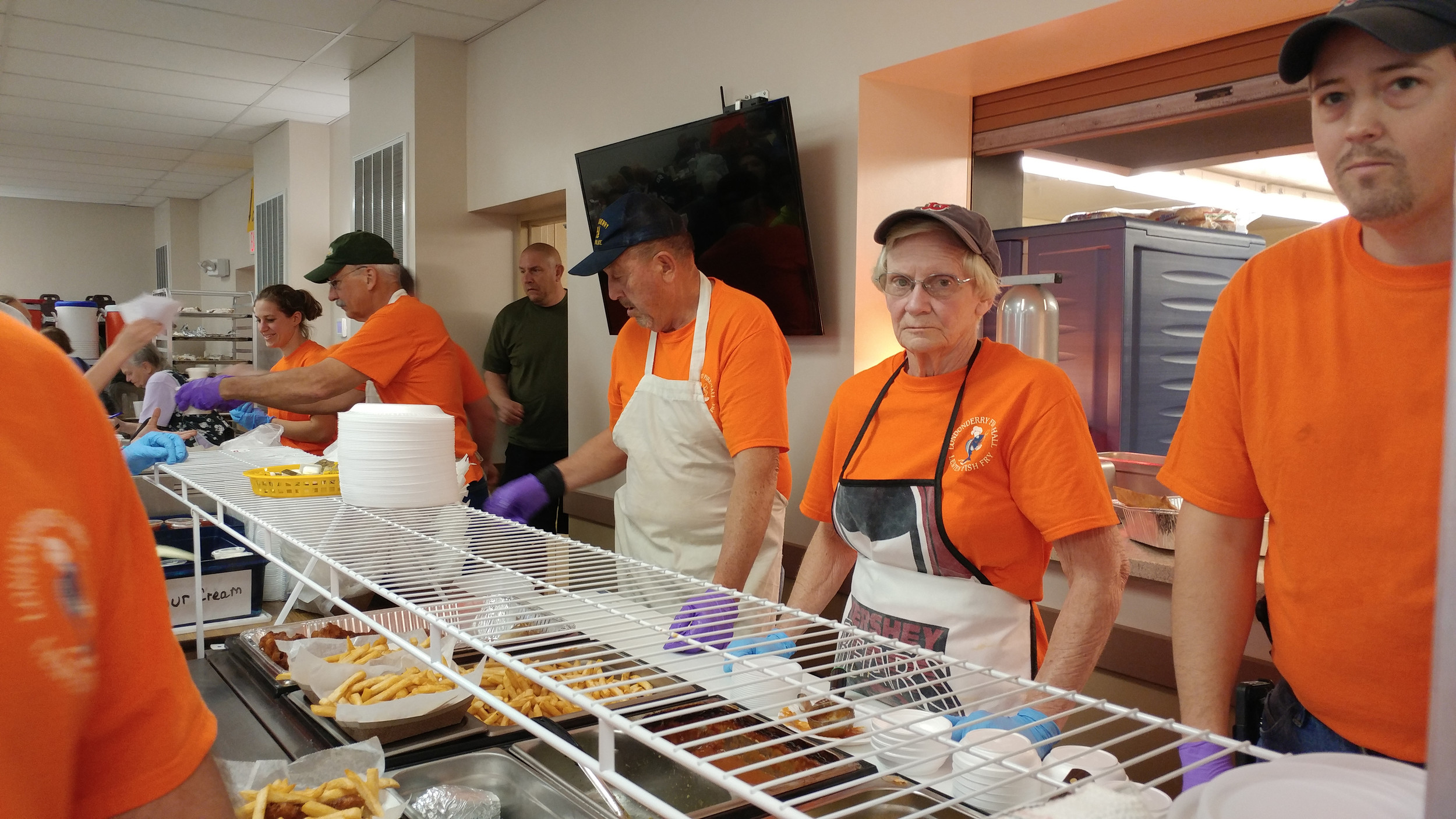 Left to right, Ivan and Sharon Arnold and Matt Naples were some of the servers preparing the trays for the runners.