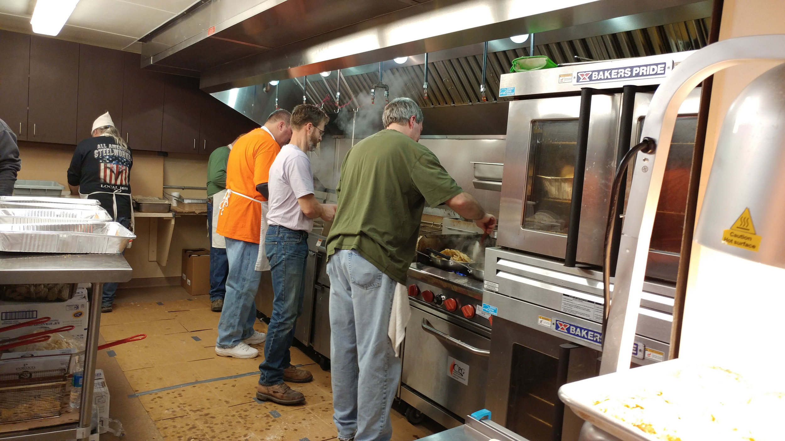 Workers in the kitchen were busy for the duration of the event making food and bringing it to the servers.