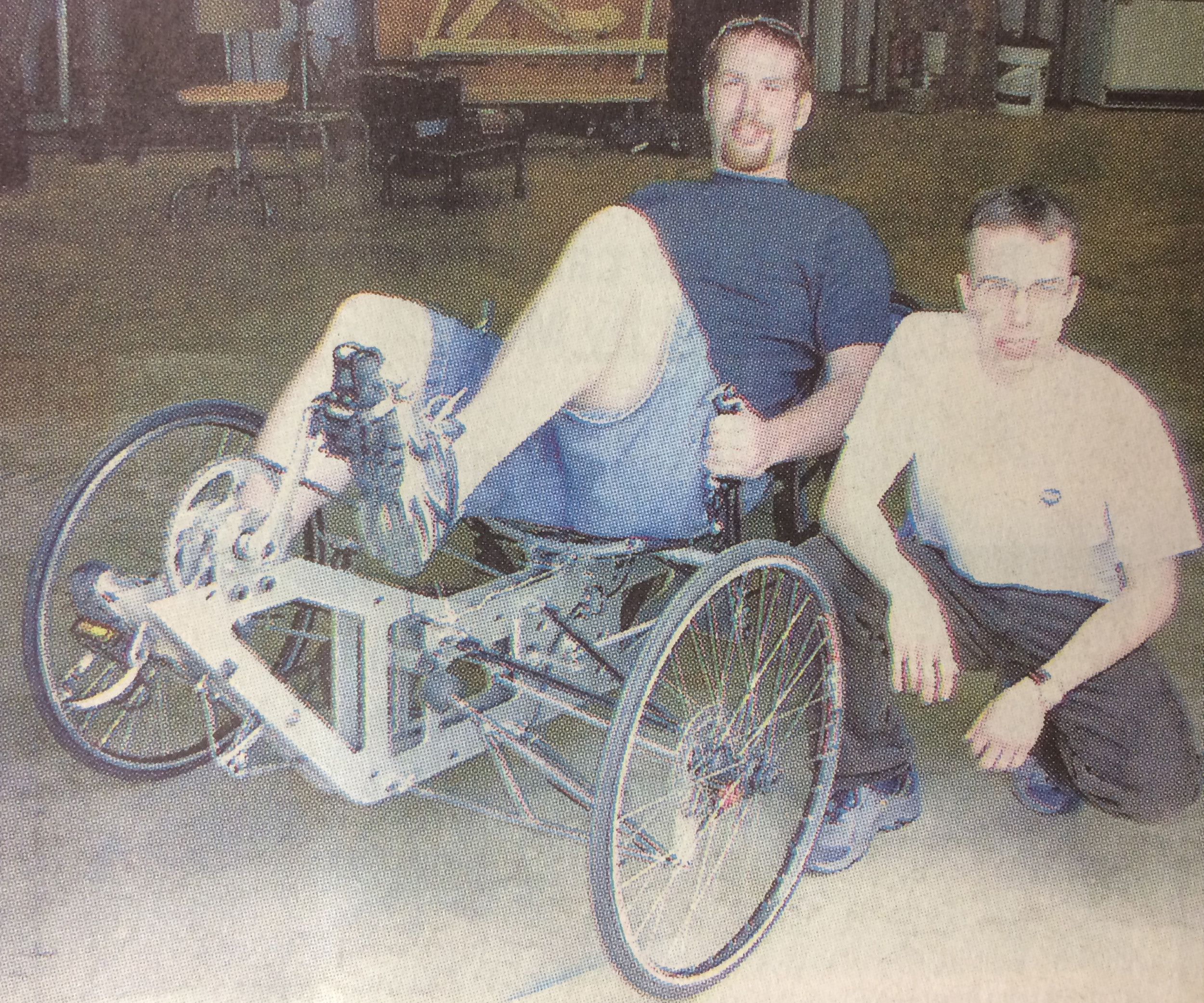 Jonathan Daniels and Andrew Gauker show off their senior engineering project, a human-powered vehicle, a recumbent tricyle design.