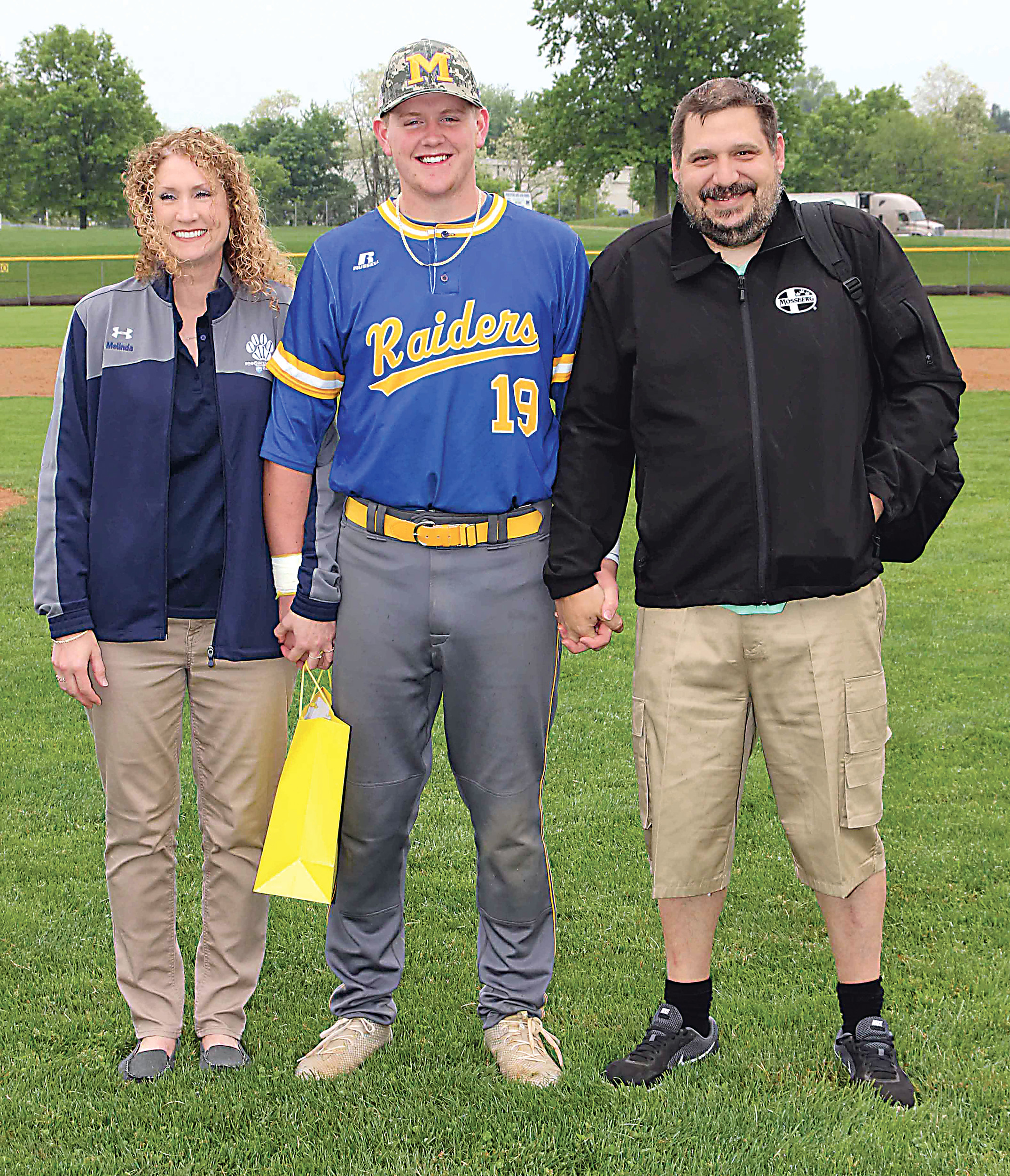 Tristen Maxwell with parents Melinda Garman and Earl Hammaker.