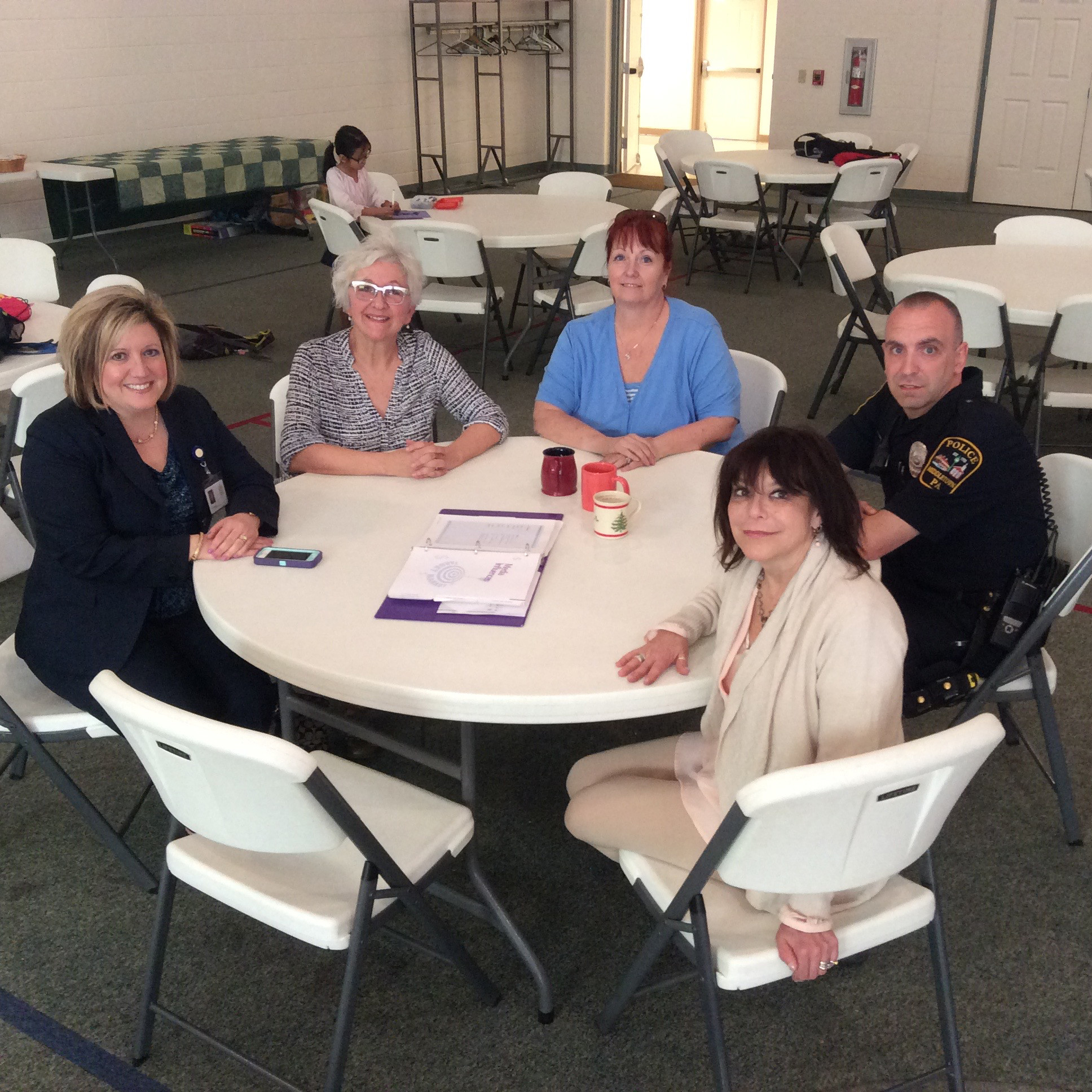 Supporters of Communities That Care gather at St. Peter's Lutheran Church in Middletown. From left are Middletown Area School District Superintendent Lori Suski, Ellen Willenbecher, Olmsted Regional Recreation Director Sue Layton-Klinger, Middletown Borough Councilor Anne Einhorn, and Middletown Police Officer Mark Laudenslager.