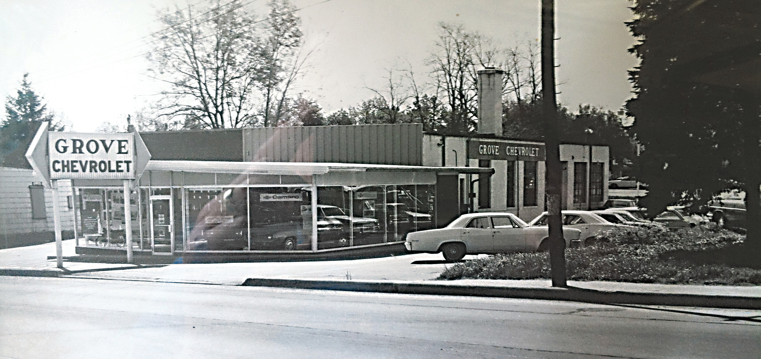 The Grove Chevrolet dealership is seen in this 1969 photo. A 1969 Camaro is visible in the front of the showroom.