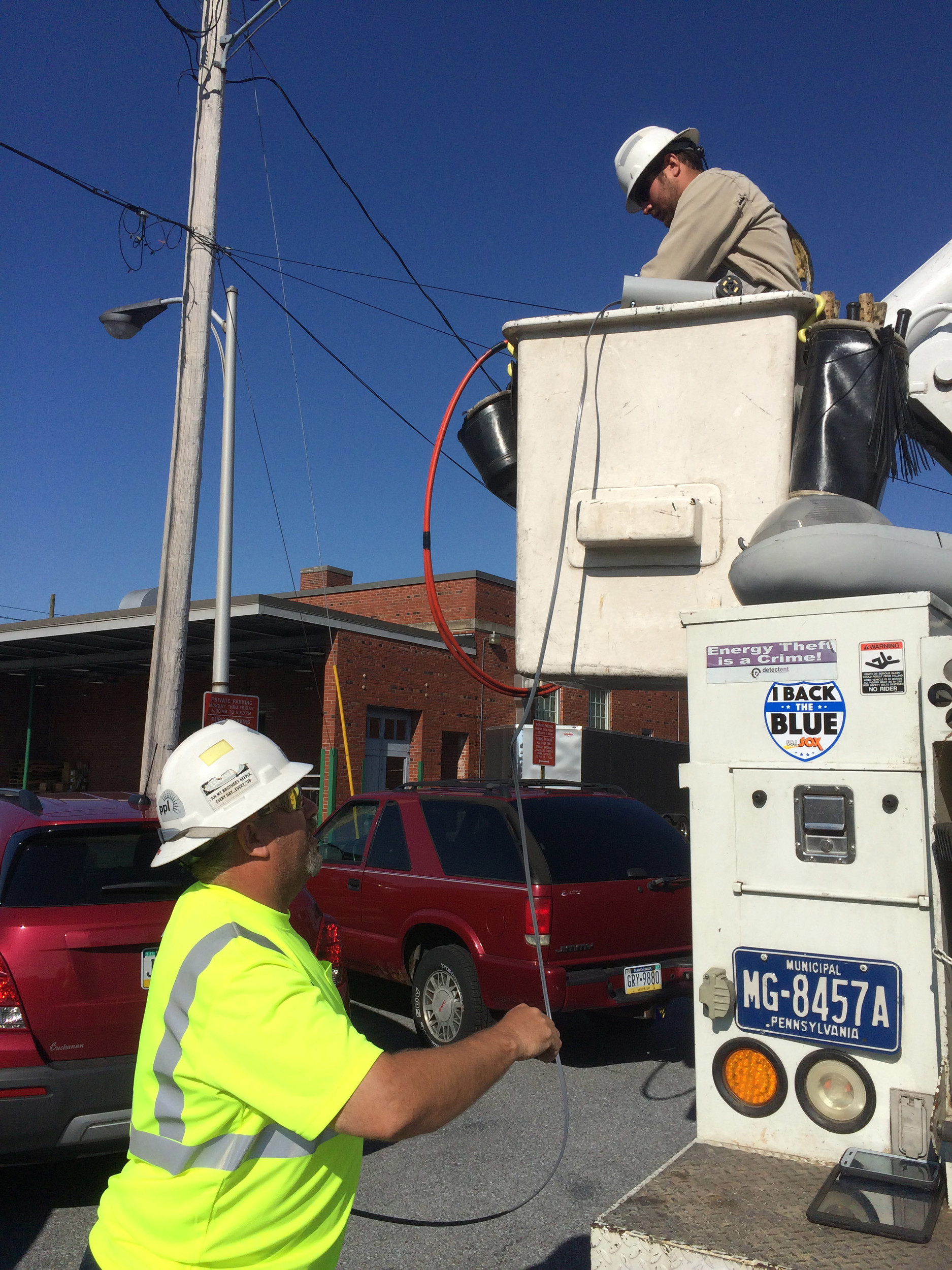 Bob Ludwig, left, and Tyler Hubbard of Middletown's public works department work on wiring for a new LED streetlight. Middletown's public works department replaced an old streetlight with a new LED one Friday morning behind the Press & Journal office at 20 S. Union St. The borough is replacing 660 lights with the new energy-efficient ones. They are almost halfway done. The light behind the P&J was the 315th. Weather permitting, it will take four or five more weeks to finish the rest.