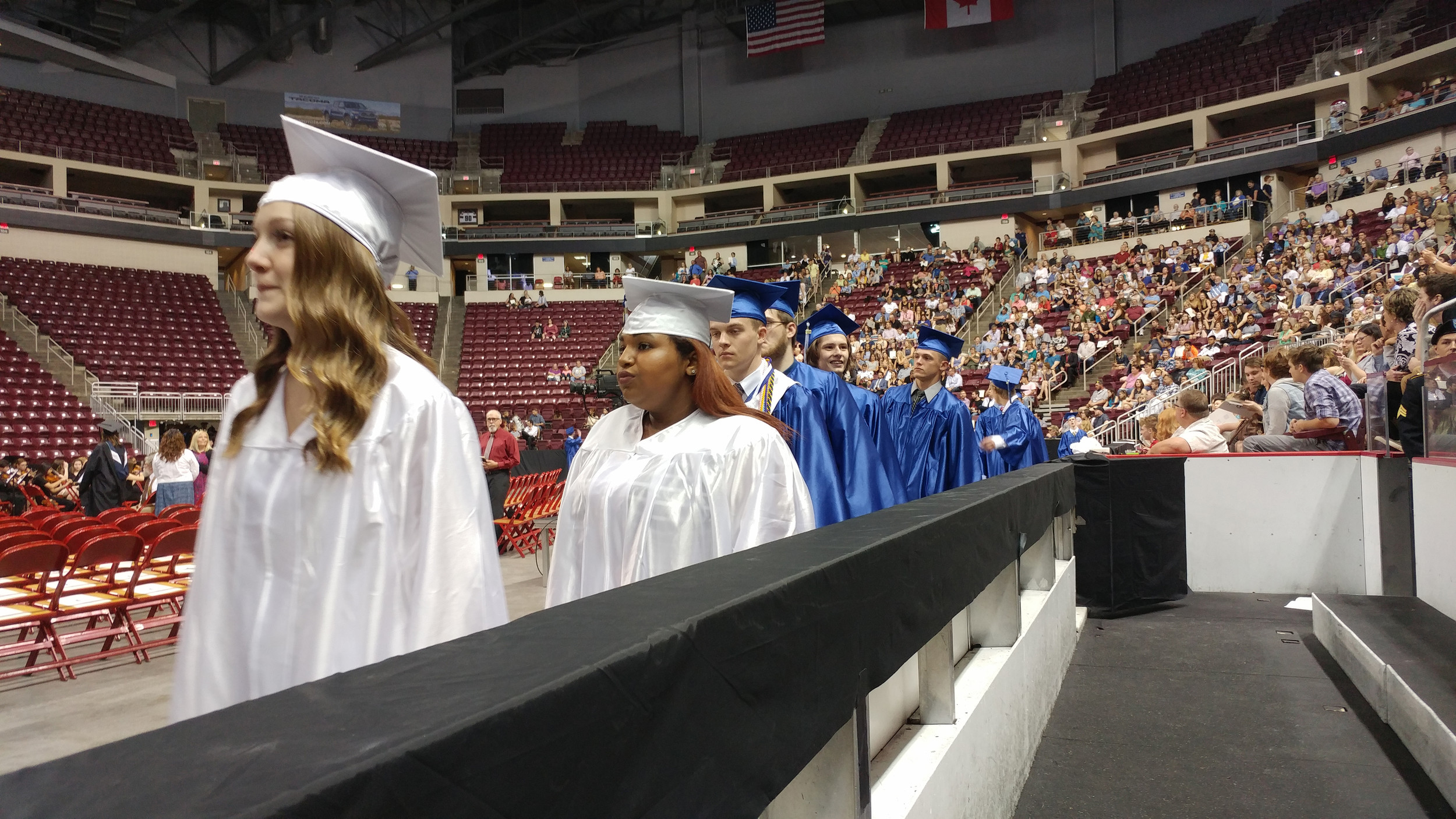 Graduates enter the arena for the start of graduation.