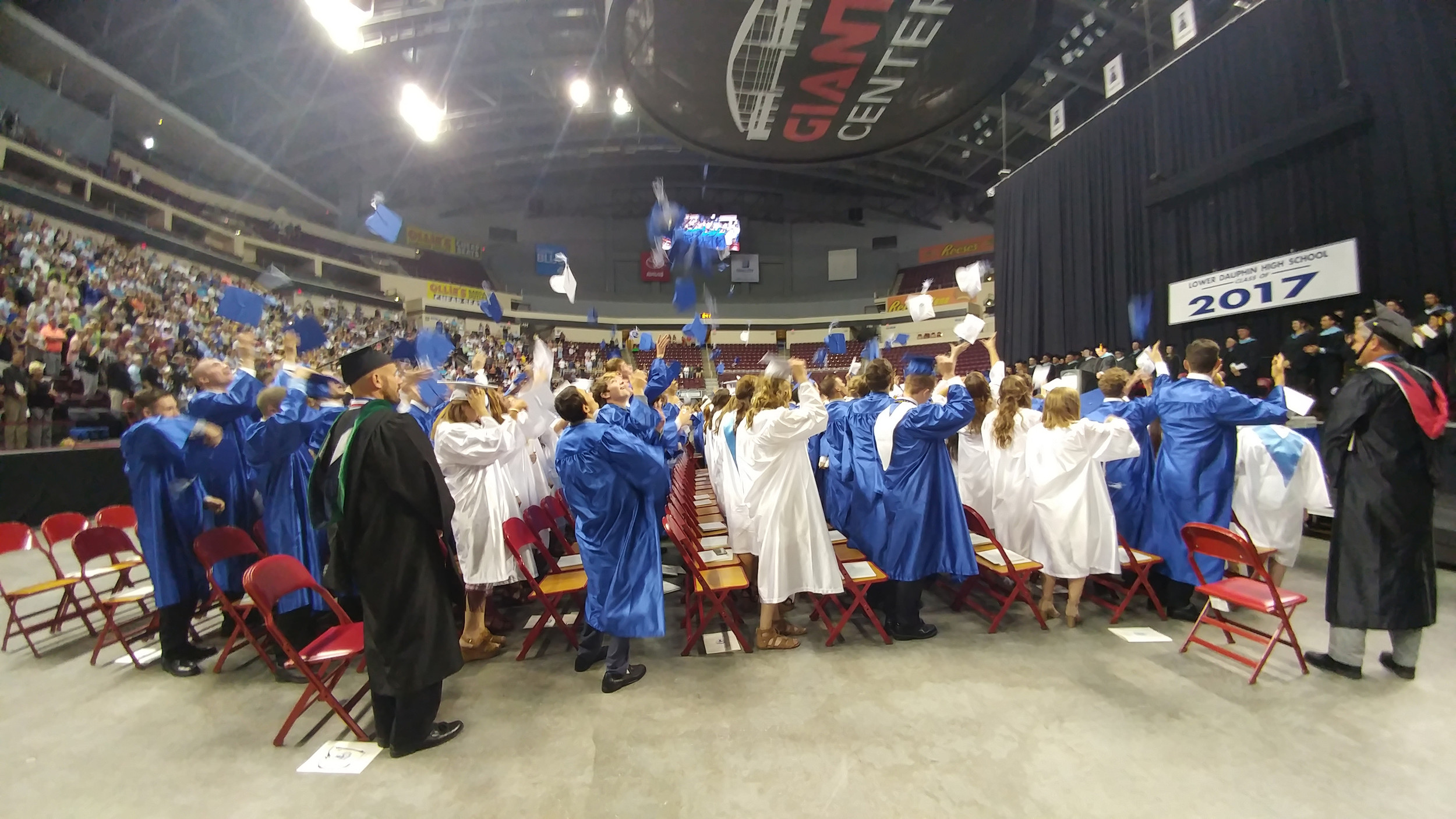 The Lower Dauphin Class of 2017 celebrates their accomplishment with a cap-tossing gesture.