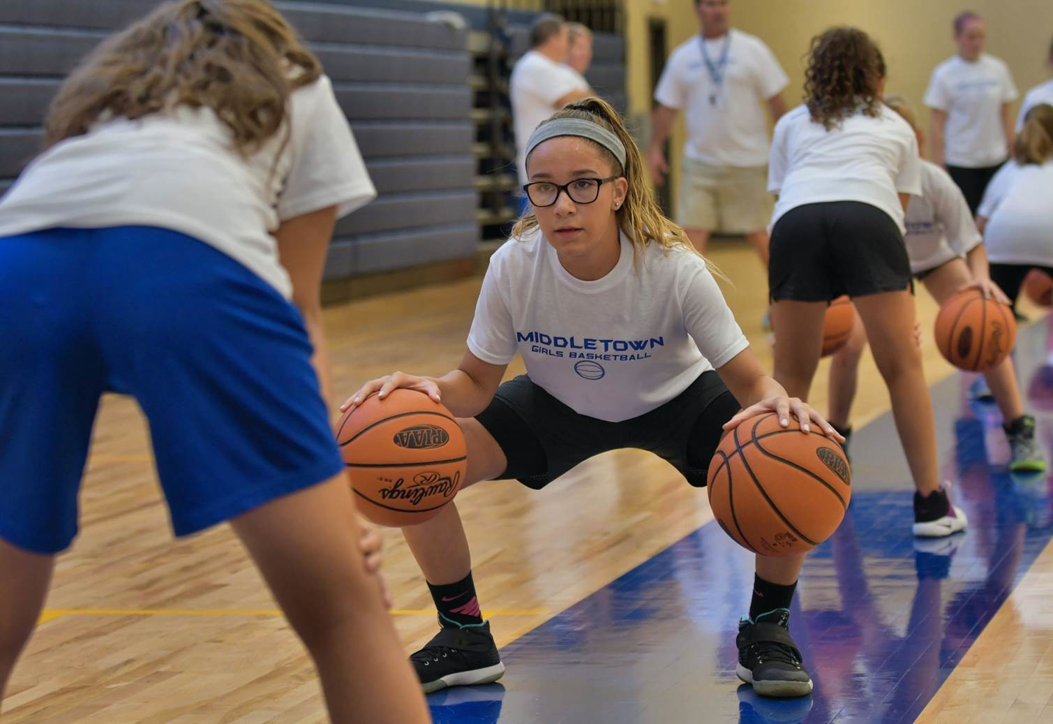 Sa'nya Togans takes part in the MAHS girls basketball clinic.
