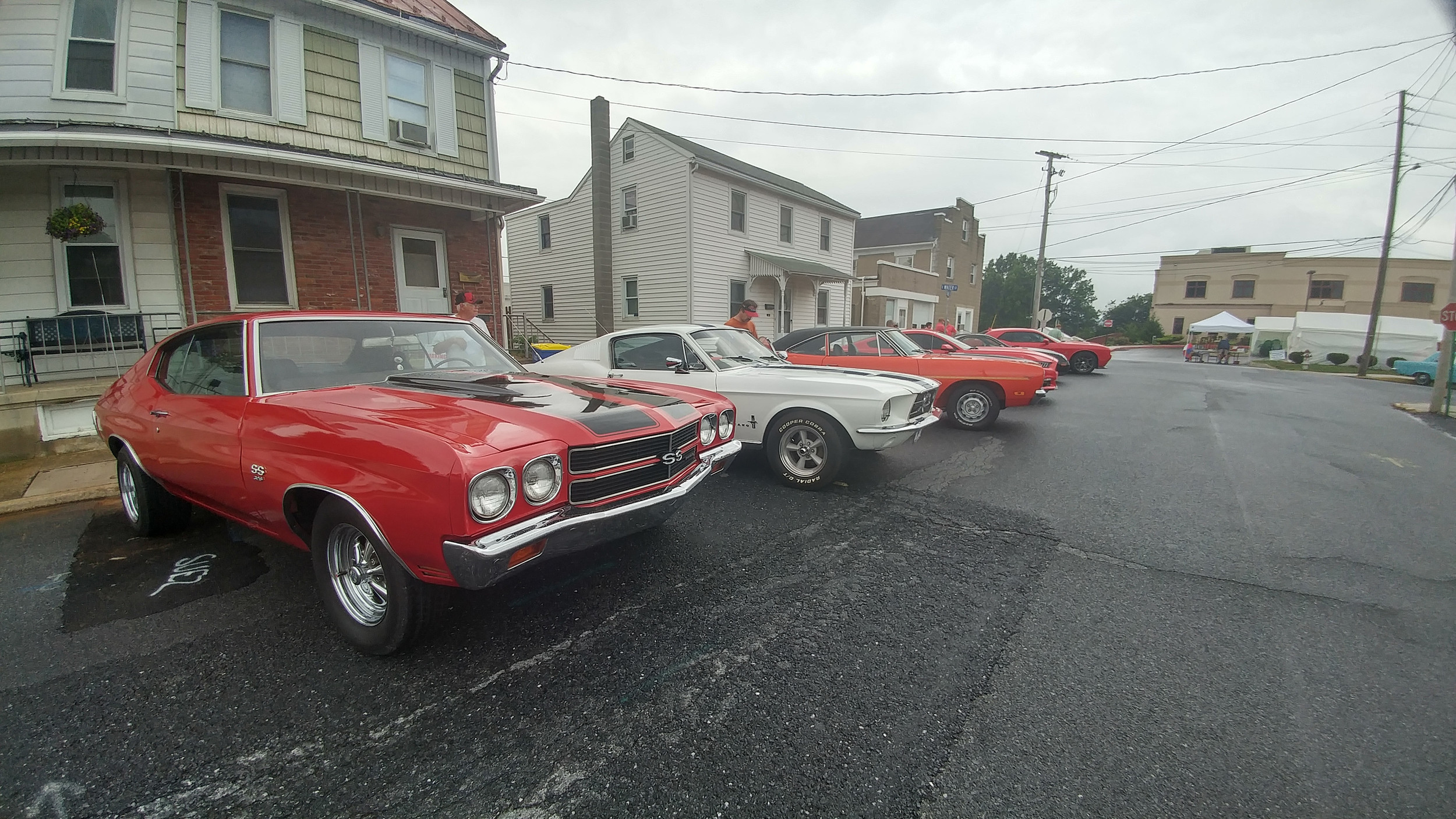 Old and new cars were on display despite late afternoon rain showers on Thursday.