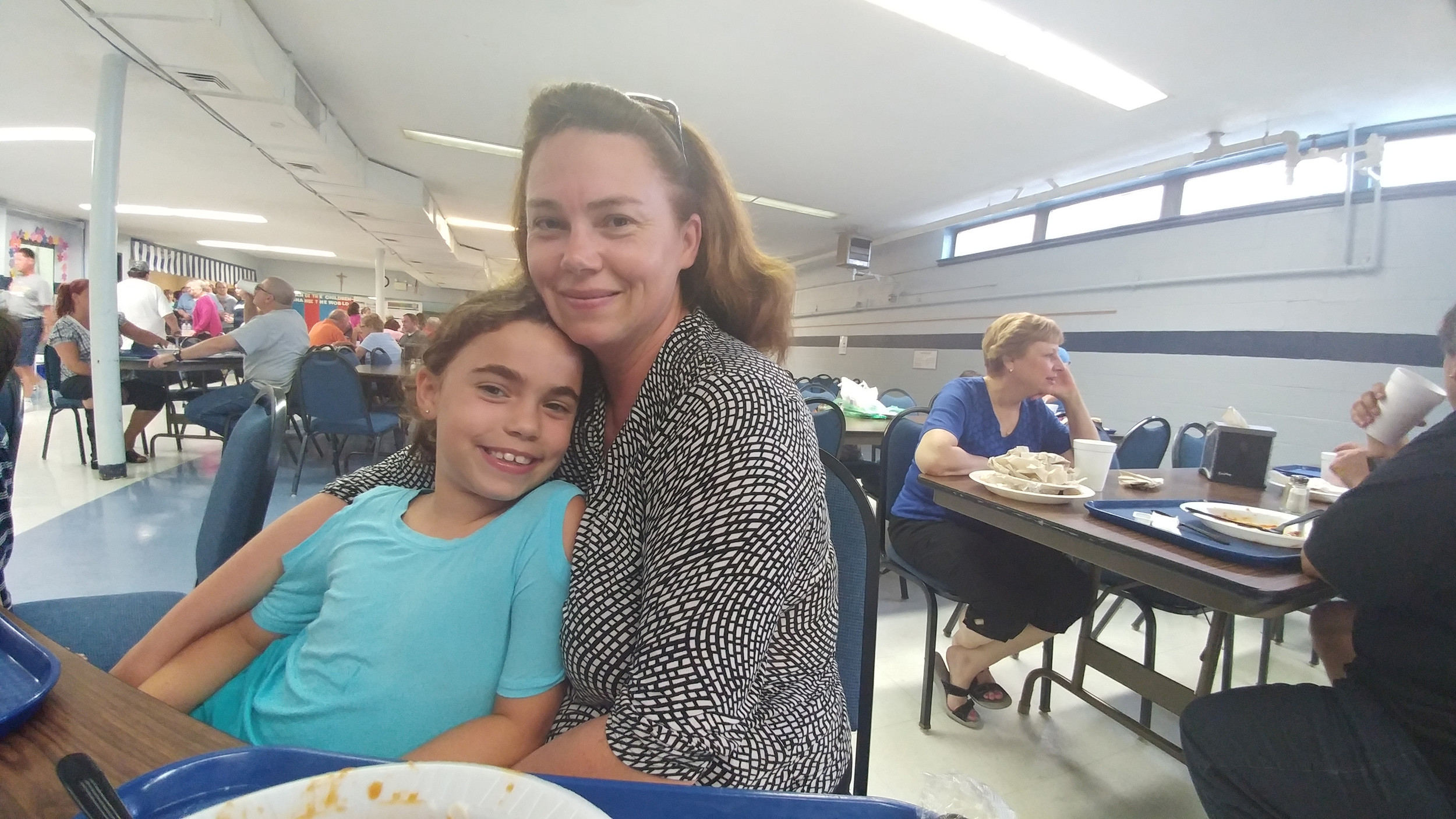 Stacey Mulligan and her daughter Mia Hohenwarter pose for the camera while enjoying dinner at the festival.