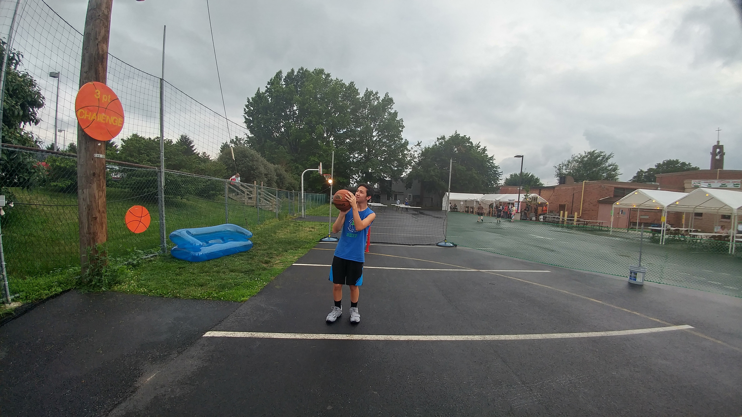 Nick Bettendorf attempts a shot at the three-point challenge game at the Seven Sorrows Festival.