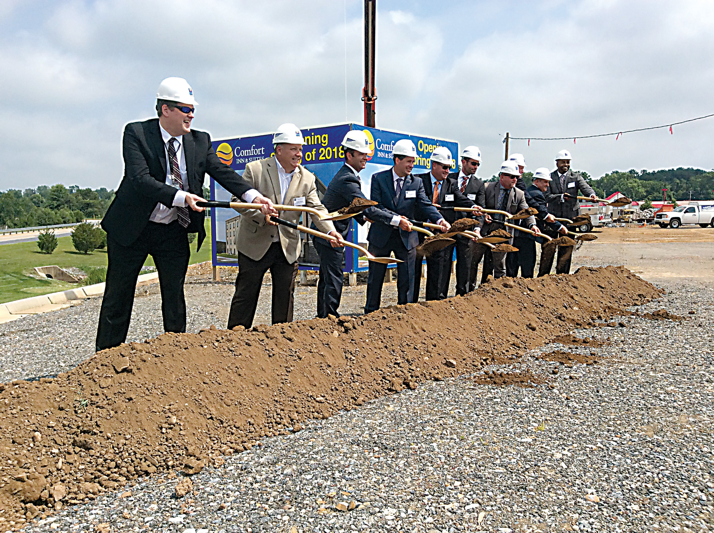 Officials with Harrisburg International Airport, local government, and developers toss dirt during the ceremonial groundbreaking for the new 87-room Comfort Inn & Suites Harrisburg Airport at the Linden Centre shopping complex along Route 230 in Lower Swatara Township on Tuesday, July 18.