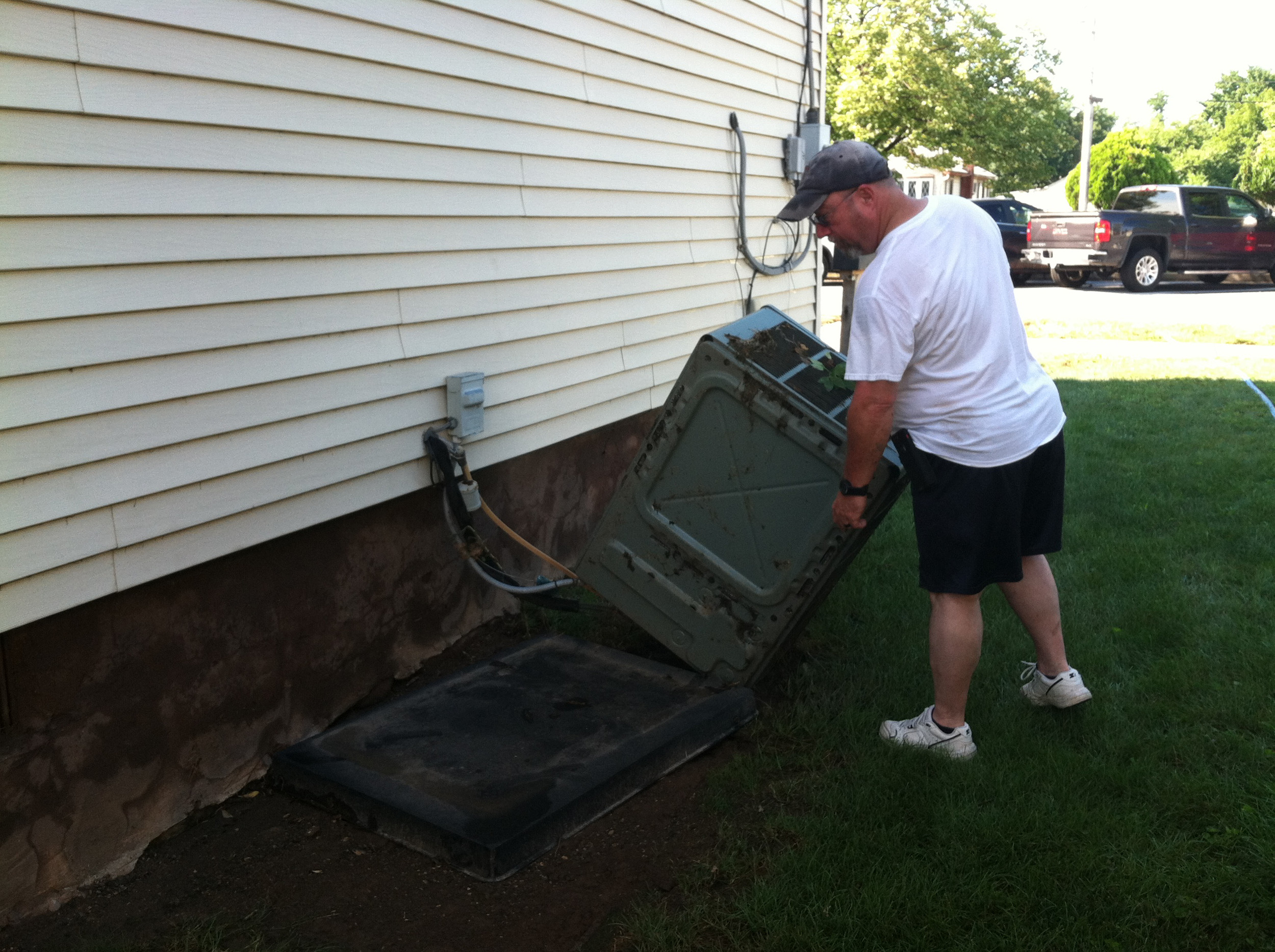 The force of the water knocked over the air conditioning unit on the side of Ken Whitebread's house on Market Street.