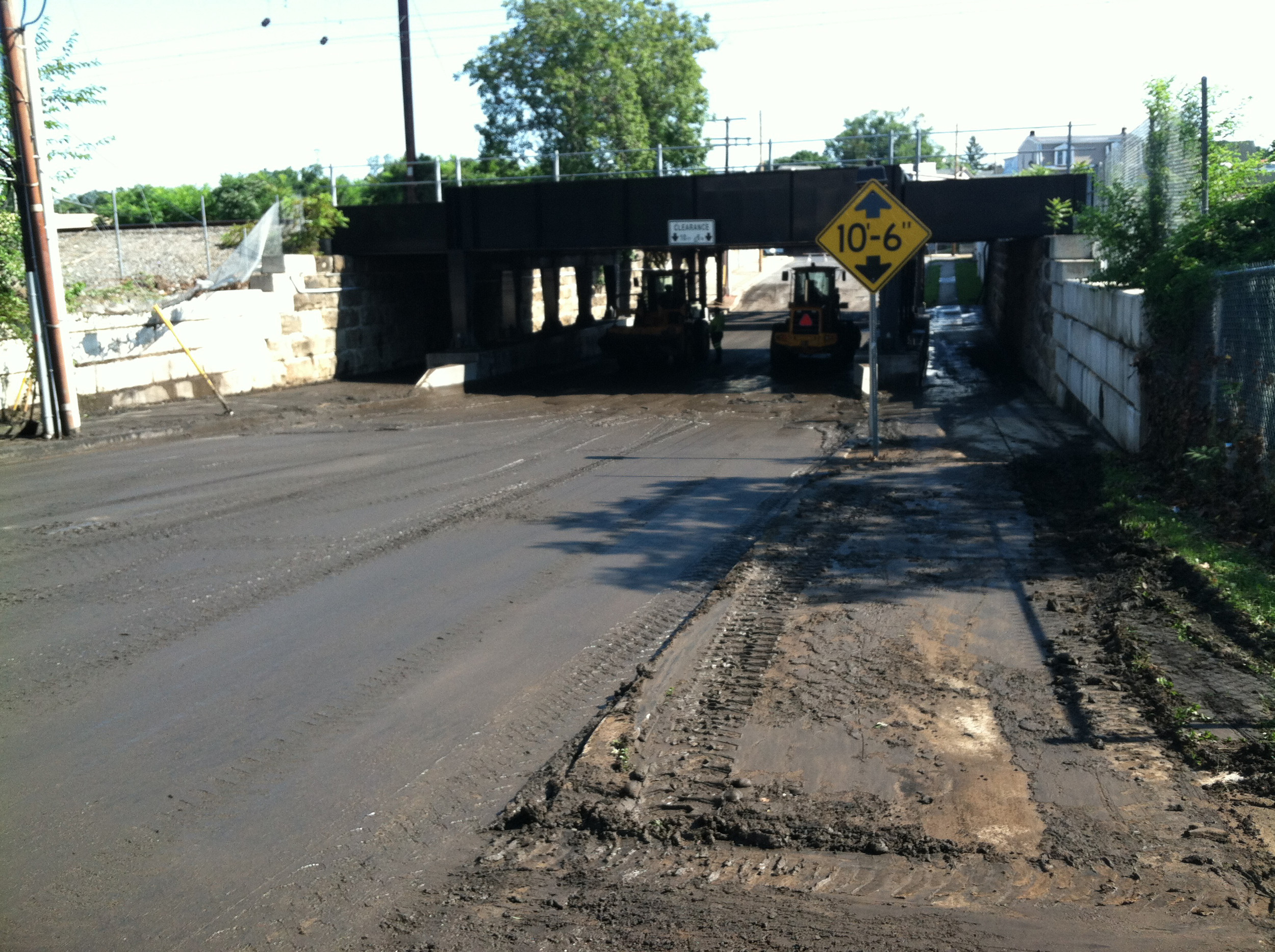 Middletown Public Works crews can be seen cleaning out the underpass on Wood Road on Monday, July 24.