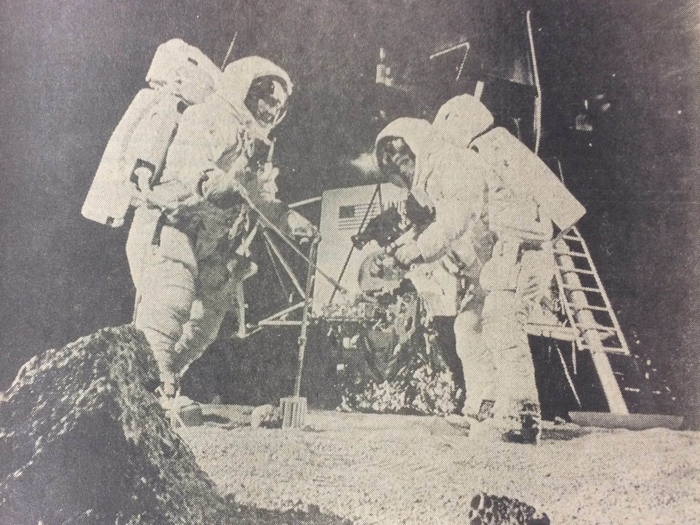 "Men of the Eagle are shown in a simulated lunar surface walk at Houston's Manned Spacecraft Center. Last Sunday night, astronauts Neil Armstrong and Edwin E. Aldrin made it a reality. At 10:56 p.m., Armstrong became the first human to step onto the moon's surface in the 2 million year history of man. His words — ""That's one small step for man, one giant leap for mankind."""