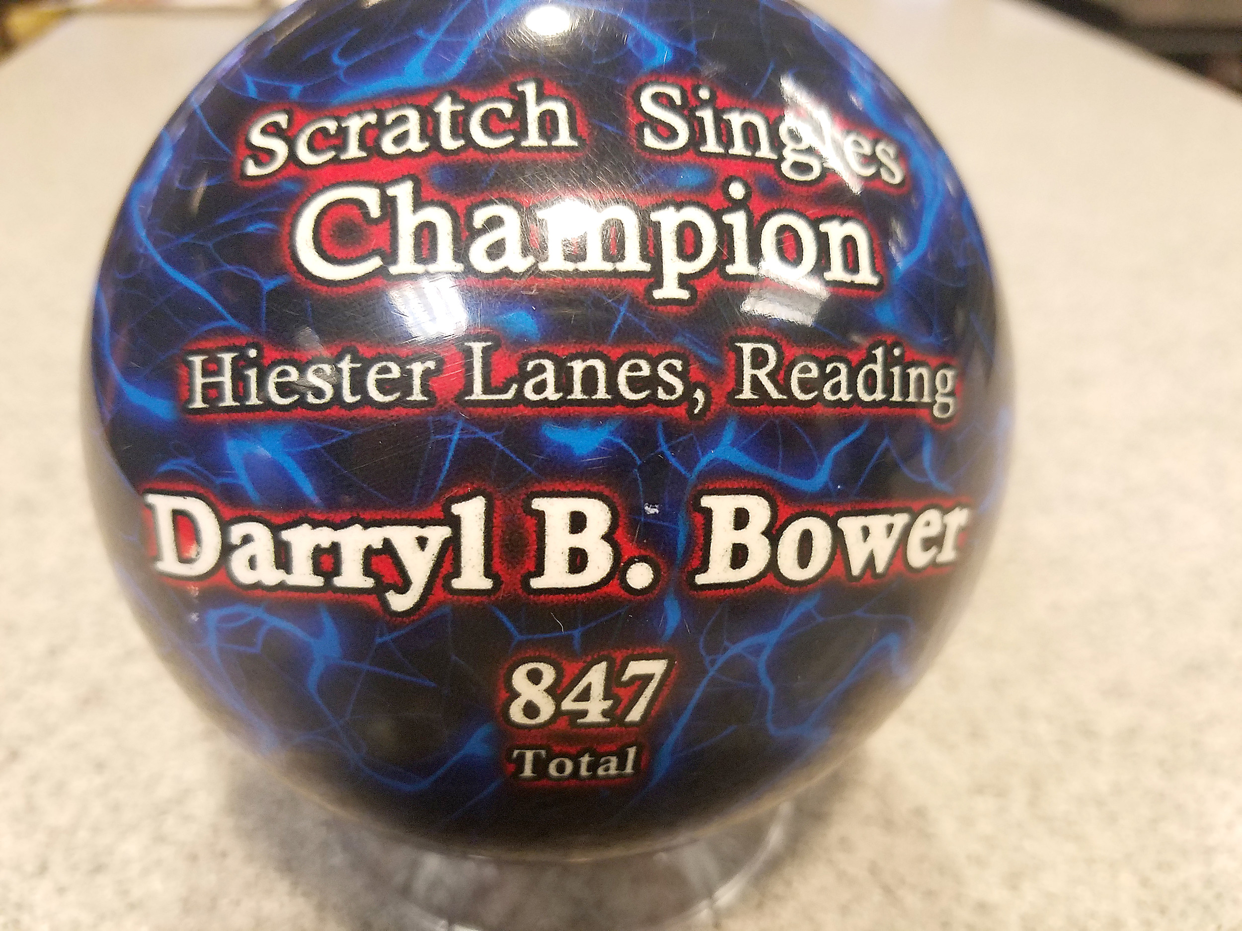 Darryl Bower received this miniature bowling bowl for winning the singles championship.