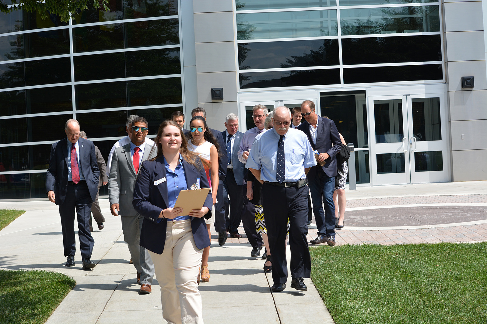 Student Emma Lerchen leads members of the Penn State Board of Trustees and University administrators on a tour of the Penn State Harrisburg campus.