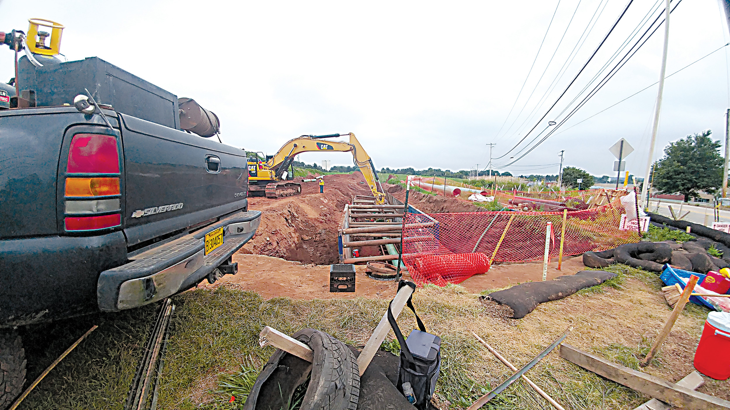 Trench construction takes place on the Sunoco Logistics Pipeline in the area between Oberlin Road and North Union Street on the afternoon of Thursday, July 27.