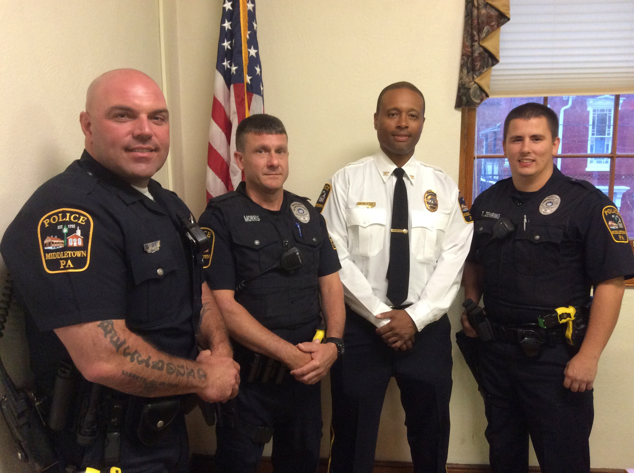 Sgt. Scott Yoder, Sgt. Dennis Morris, Chief George Mouchette, and Patrolman Tyler Zehring.