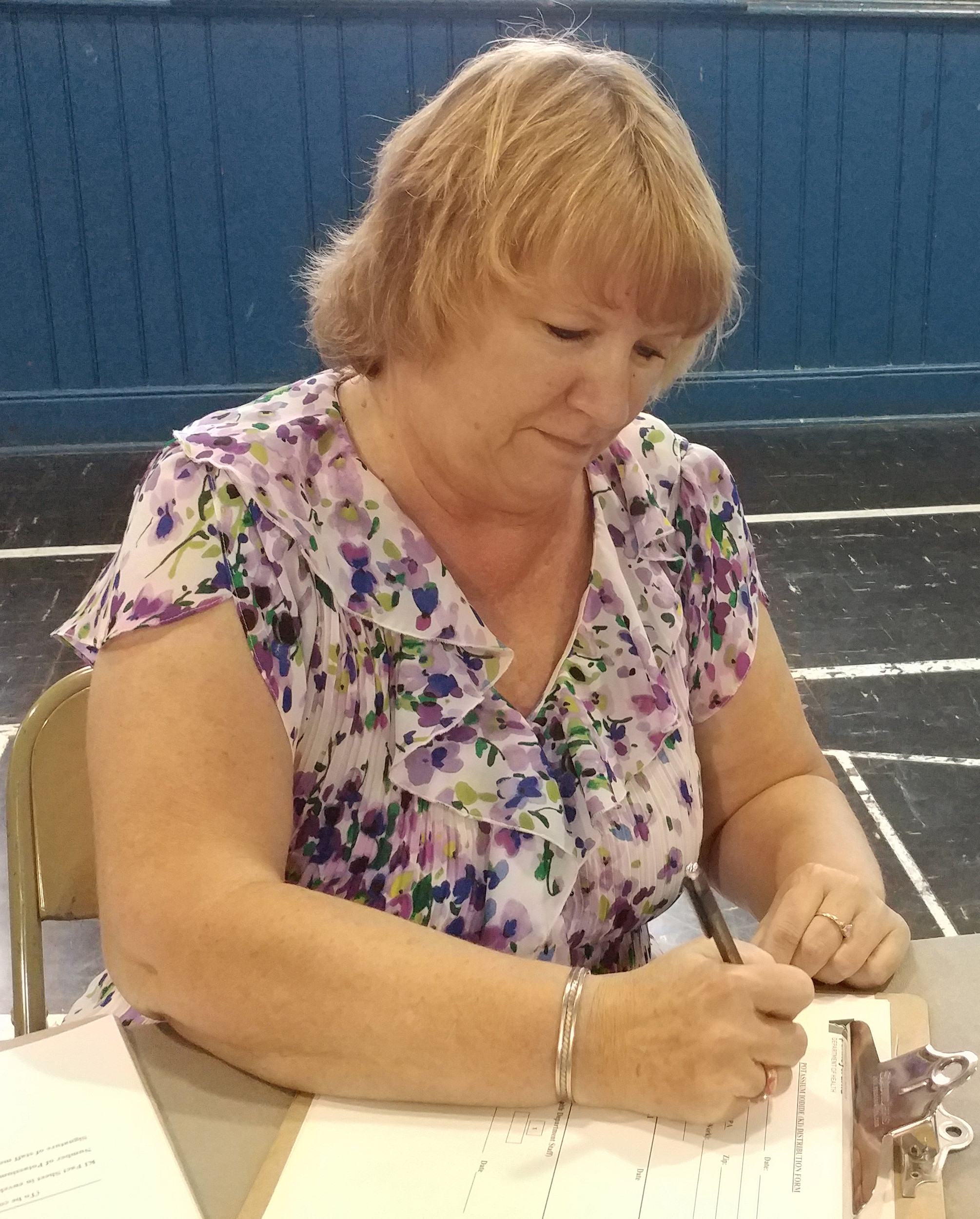 Cheryl Walker of Middletown fills out the paperwork for free potassium iodide pills at the MCSO Building on the evening of Aug. 24.