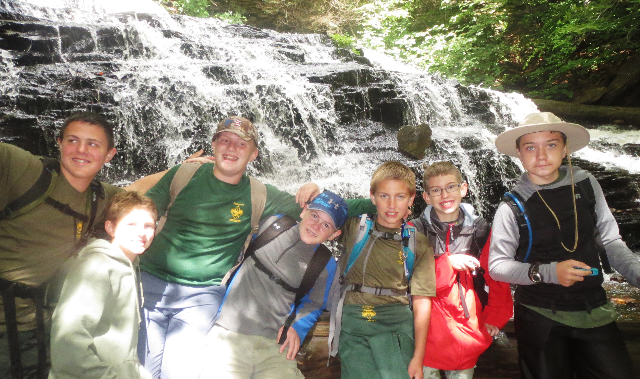 Ben Spangenberg, Bryson Harris, Mason Swartz, Luke Spangenberg, Leo Nissley, Joe Myers and Mason Barrick laugh as Mother Nature tickles them with the spray from one of the waterfalls that they encountered during a campout at Ricketts Glen State Park.