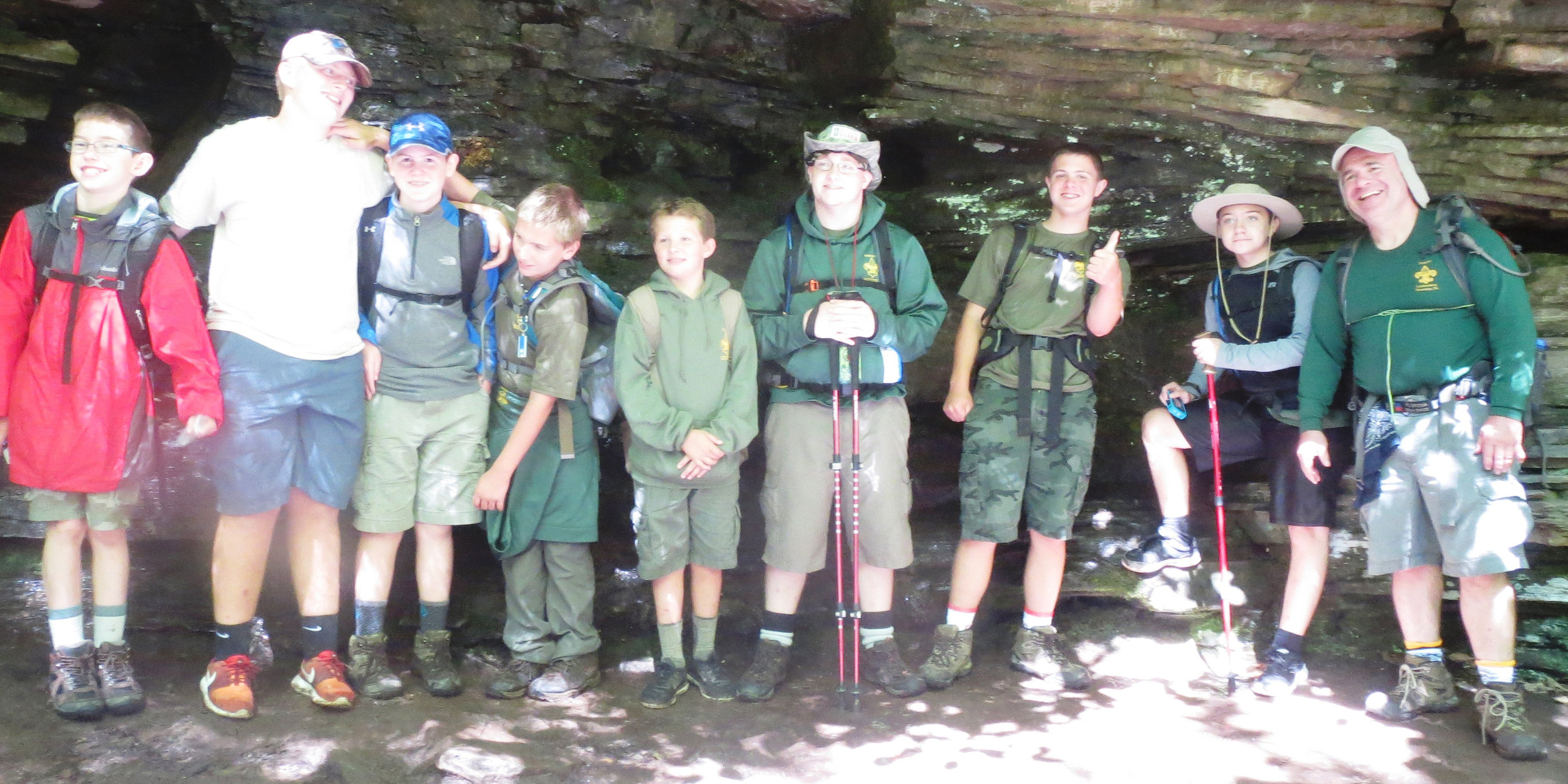 Joe Myers, Mason Swartz, Luke Spangenberg, Leo Nissley, Bryson Harris, Kyle Hoyt, Ben Spangenberg, Mason Swartz and Scout Master Kevin Little stand before rock formations that were compressed by glaciers thousands of years ago.