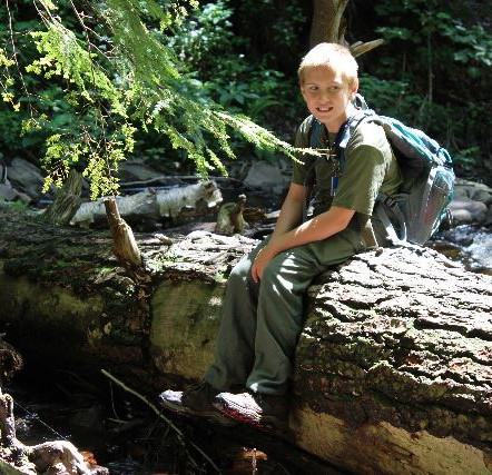 Leo Nissley found a sturdy log where he could relax and listen to the babbling brook that ran beneath him.
