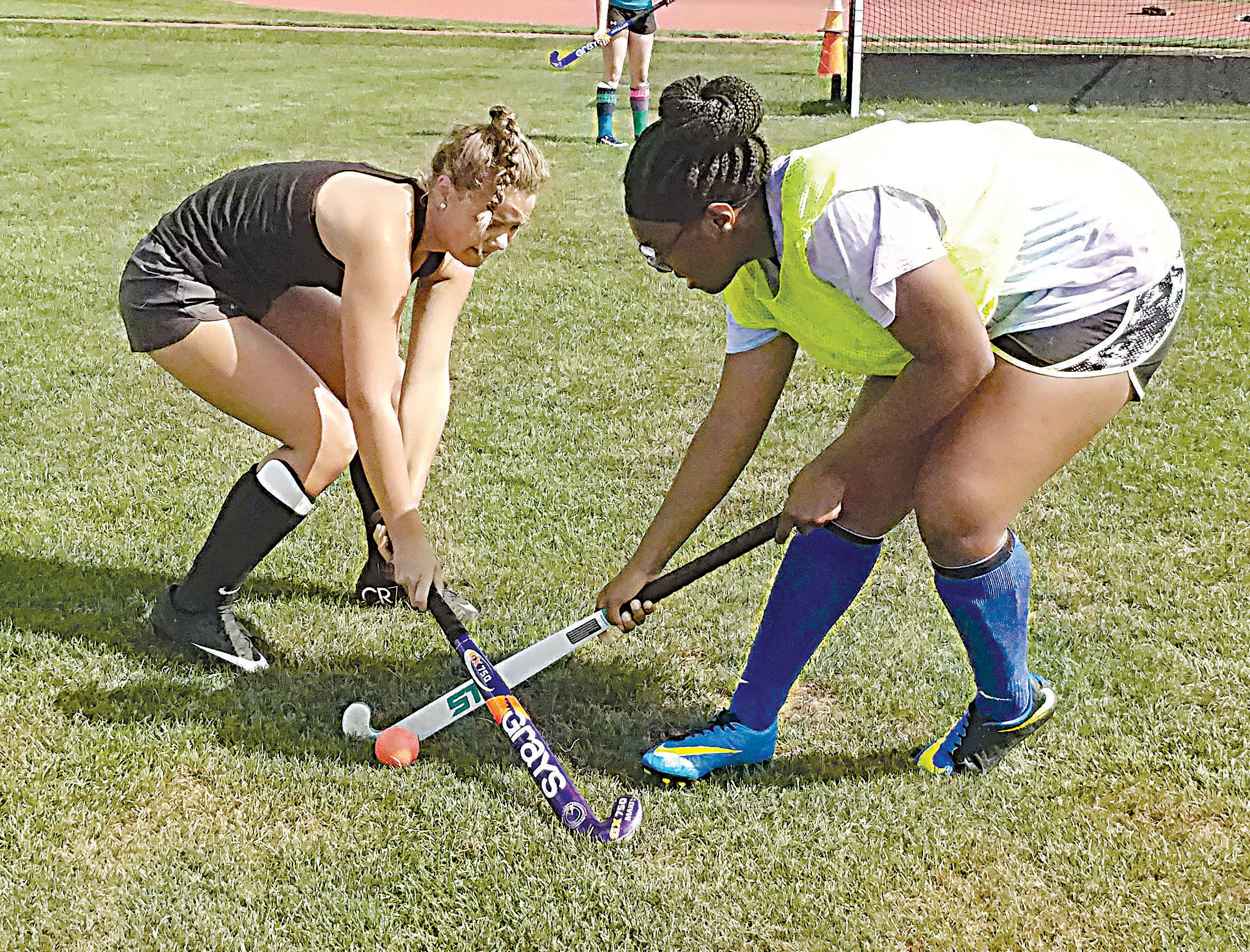 Noelle Zimmerman and Deja Washington face off in a drill during field hockey practice on the morning of Aug. 25.