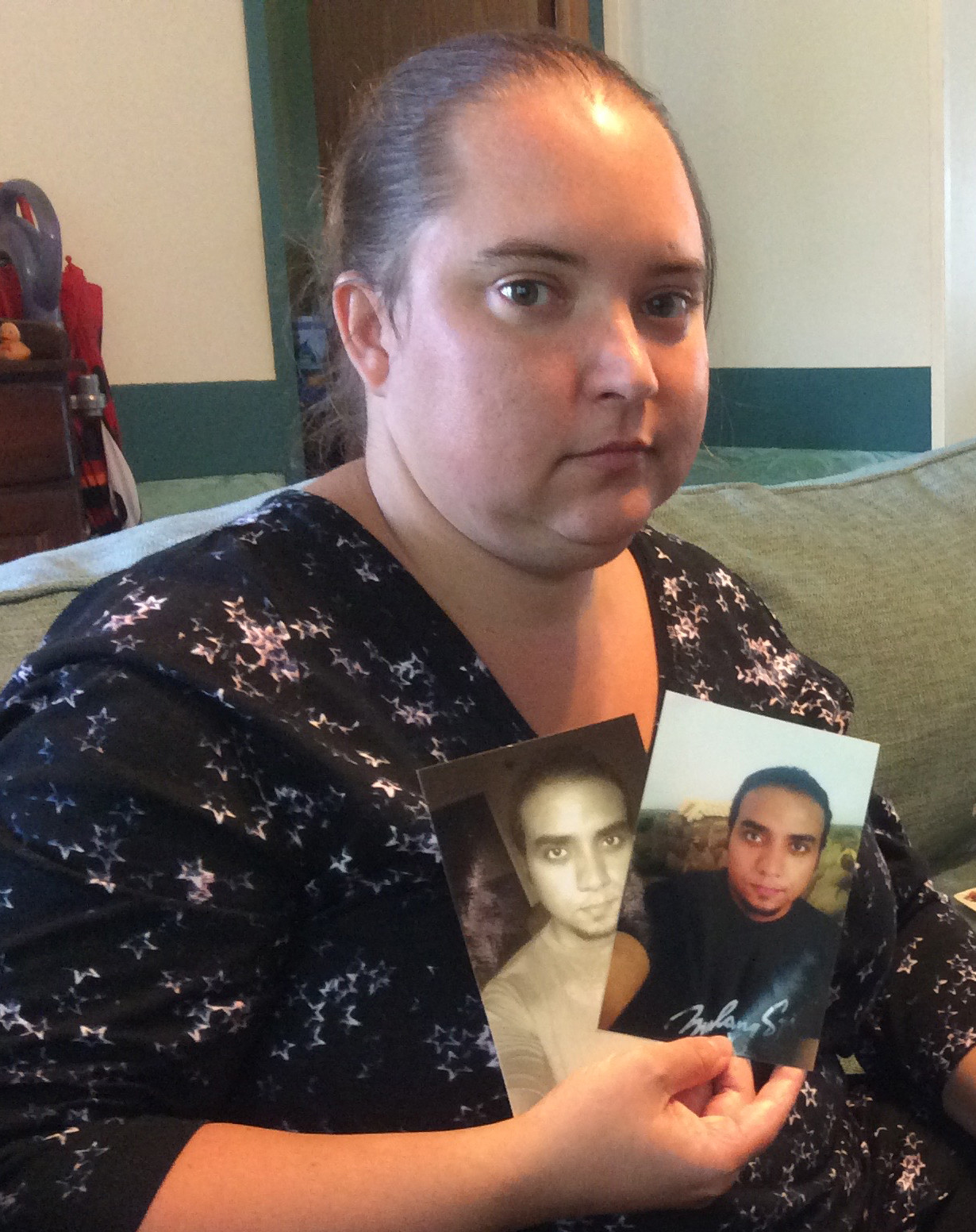 Jennifer Hassan holds two photos of Hany Mohamed that Hany sent to her from Egypt before they met face to face for the first time in 2013.