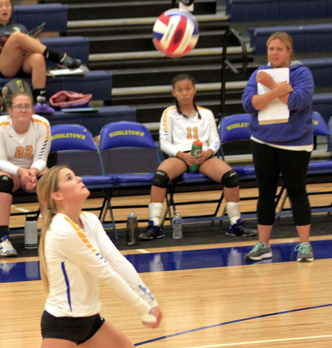 Coach Lisa Huber, right, watches senior Ivy Martnishn as she returns vs. Trinity on Monday, Sept. 11.
