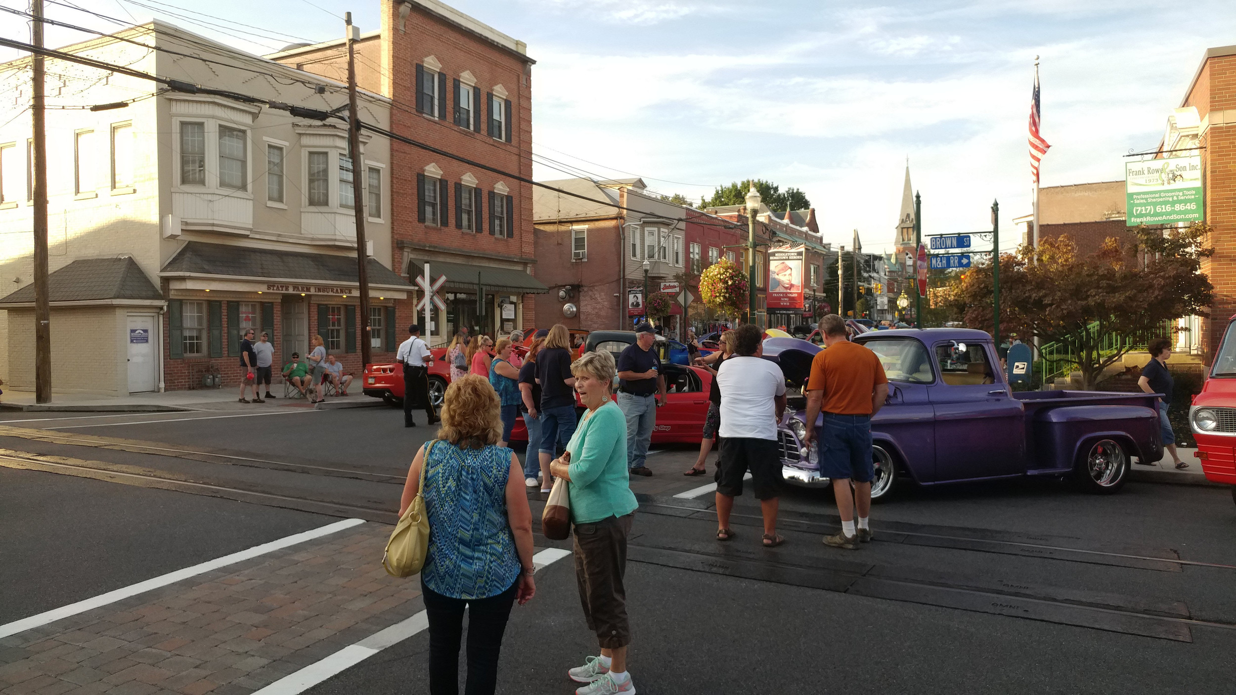 Visitors mingle and examine the cars at the corner of Union and Brown streets at the 2017 Kuppy's Cruise-In.