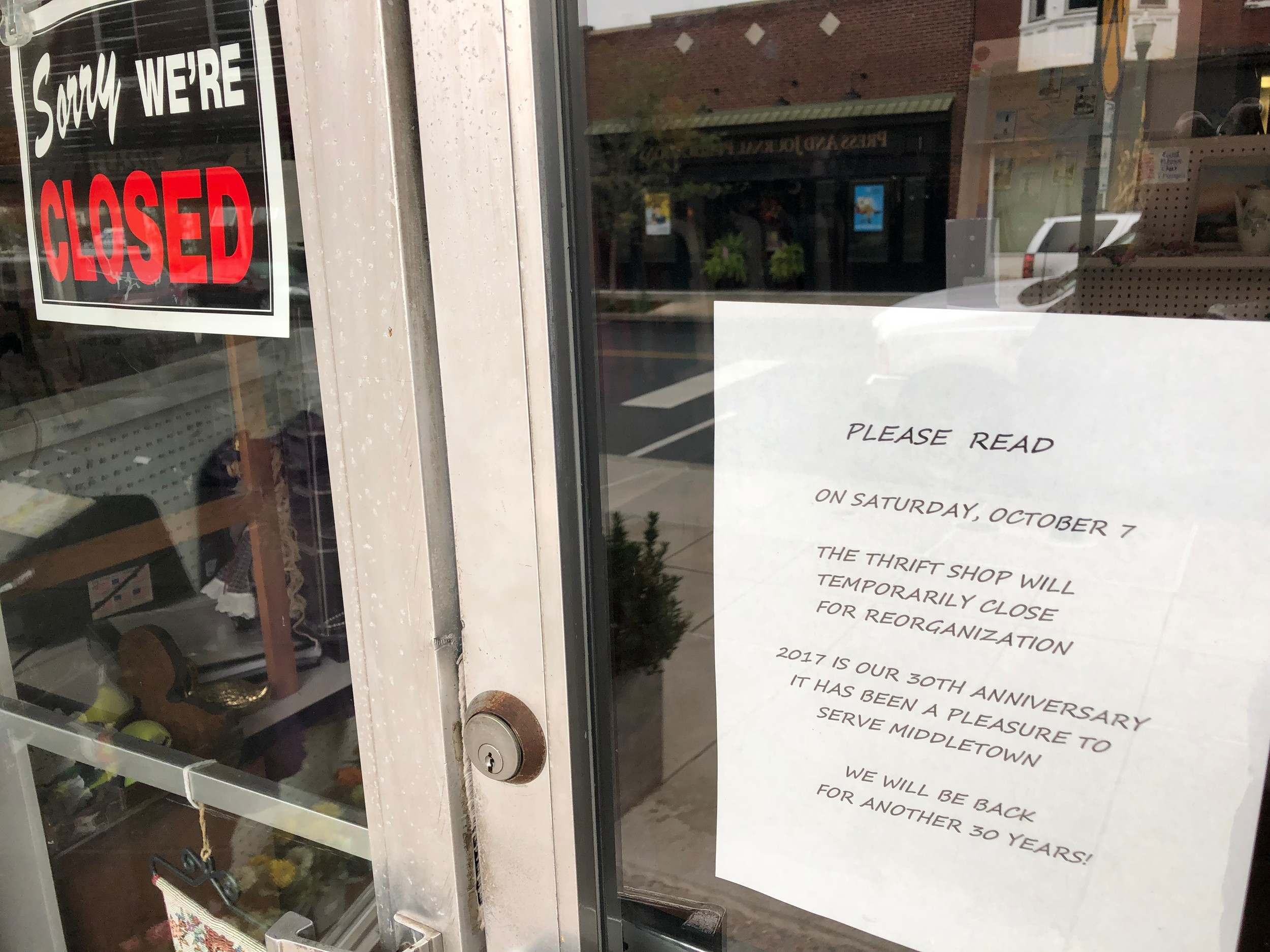 A sign hangs on the door of the Middletown Interfaith Senior Service Thrift Shop explaining why it isn't open.