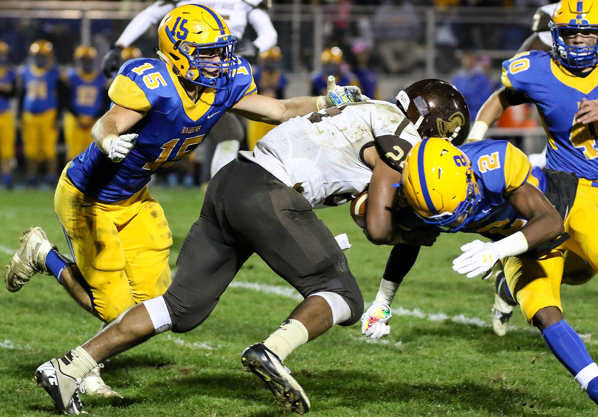 Blue Raiders Blake Jacoby and Tyreer Mills take down Milton Hershey ball carrier Naeem Cross.