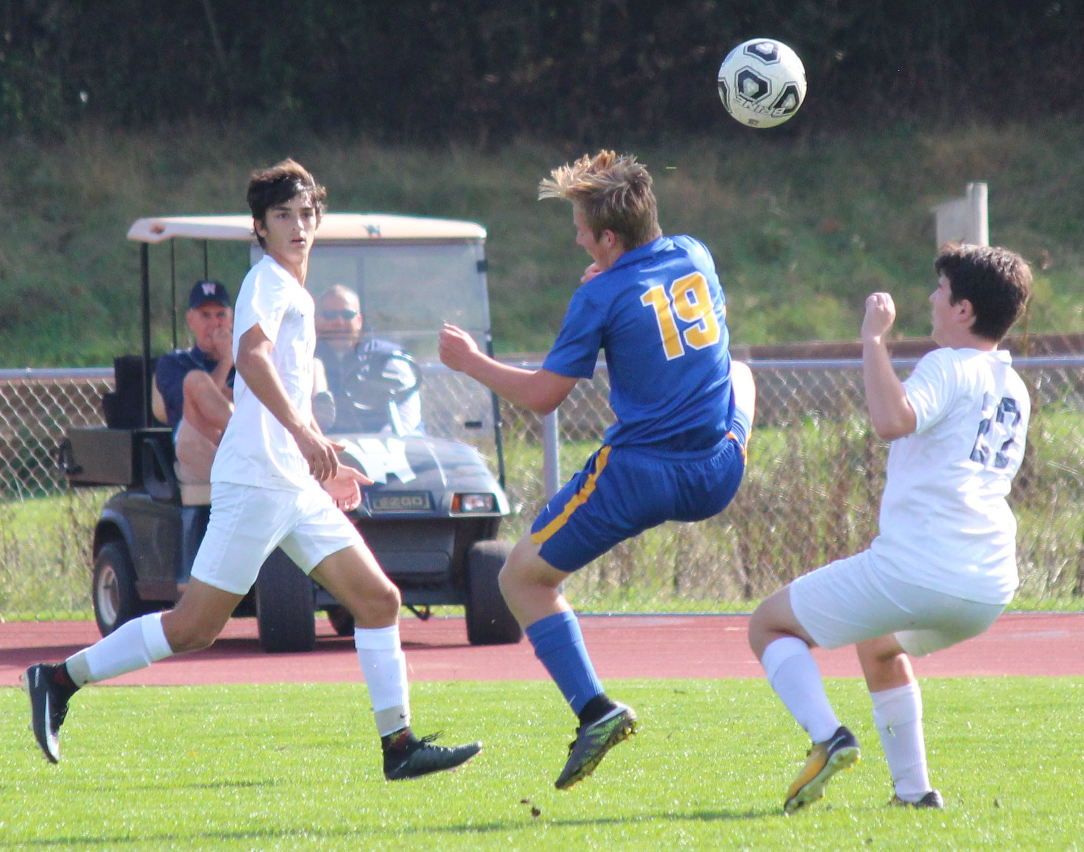 Joey Spear battles with two Wyomissing players.