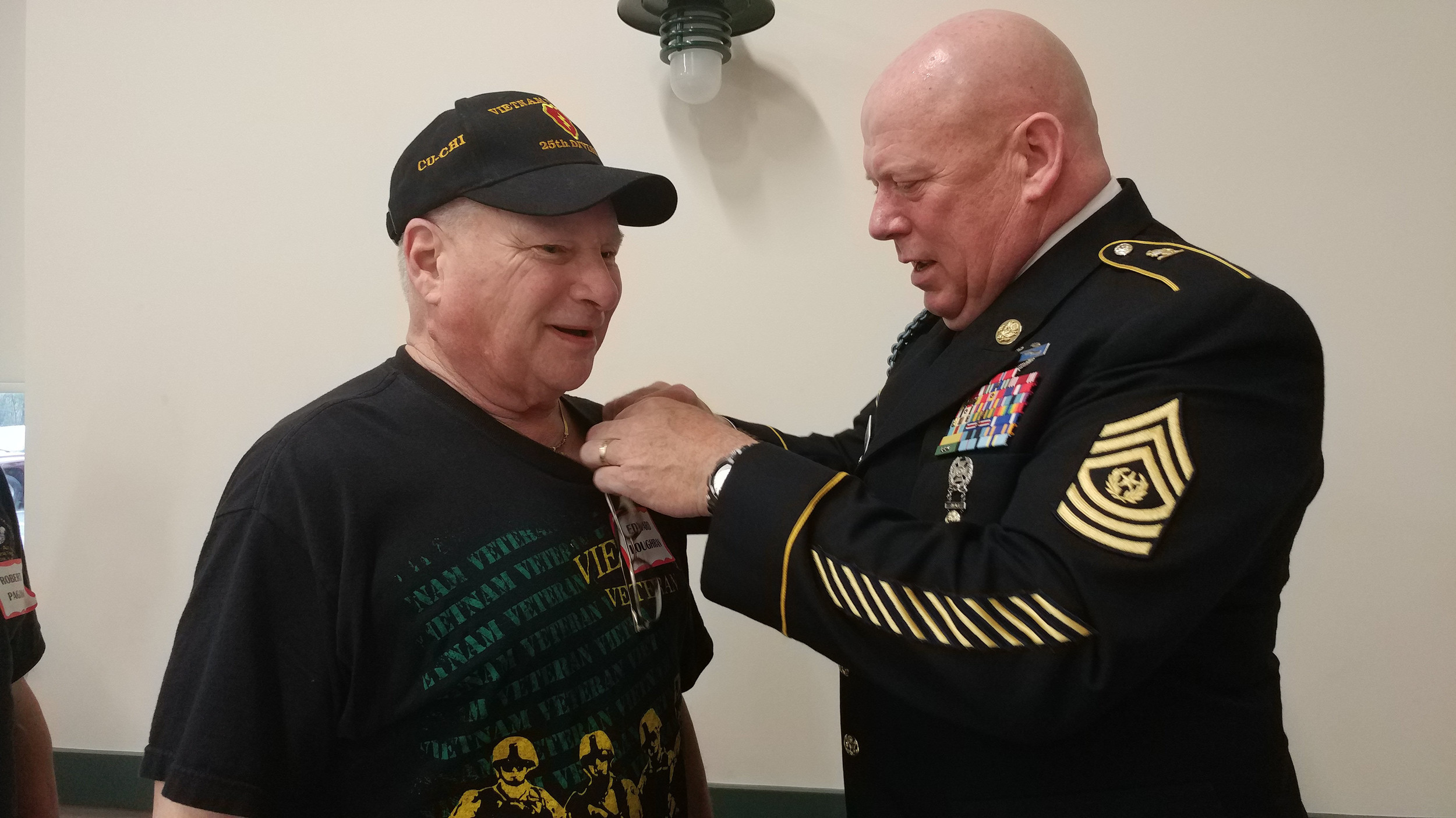 Edward Loughran receives his Vietnam Veteran lapel pin from Sergeant Major Harry J. Buchanan III Friday, Nov. 3 at the 2017 Veterans breakfast and recognition ceremony.