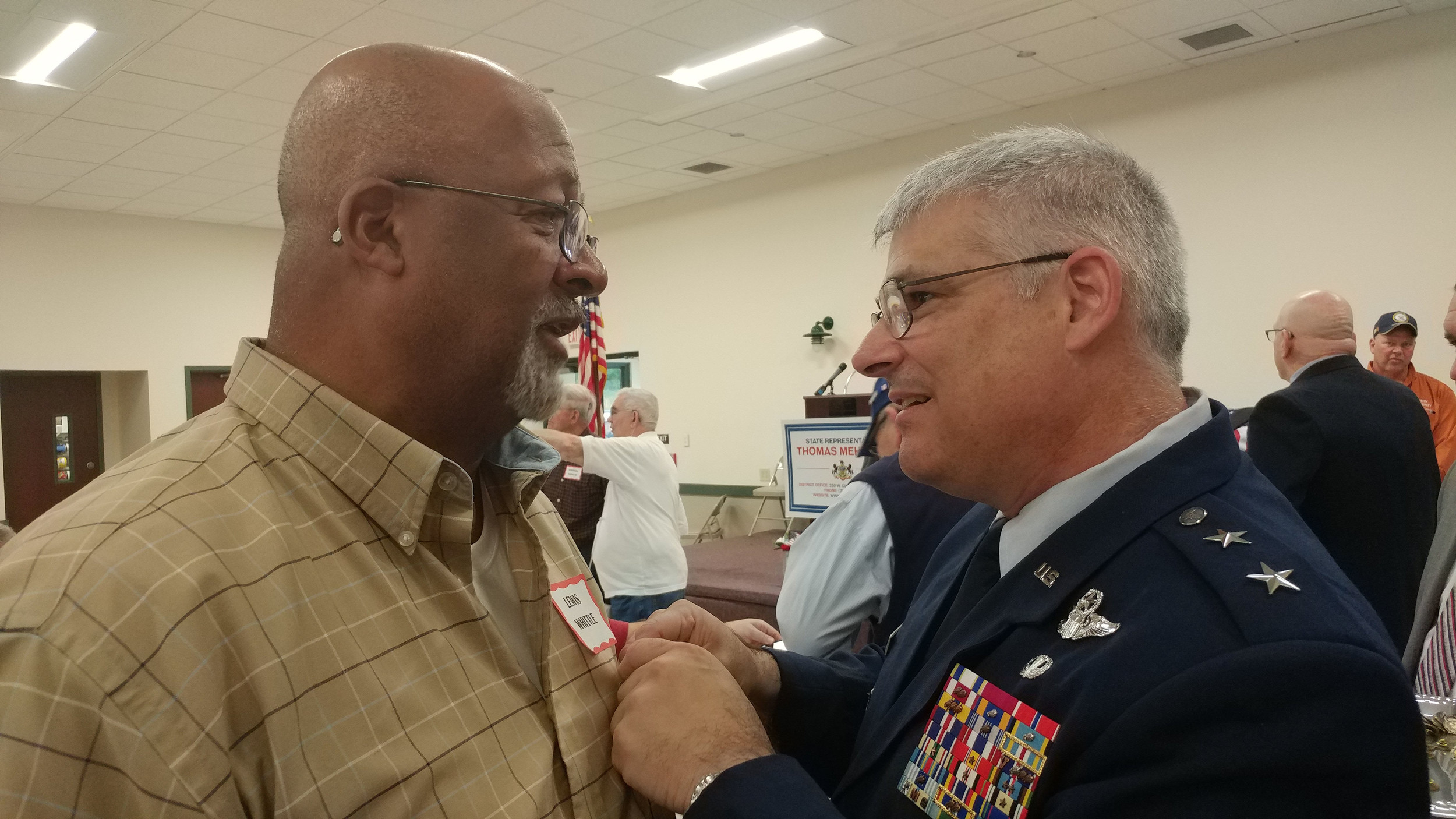 Major General Anthony Carrelli chats with Lewis Whittle as he presents Whittle with his Vietnam Veteran lapel pin during the 2017 Veterans breakfast and recognition ceremony, Friday, Nov. 3 at the Lower Swatara Fire Department.