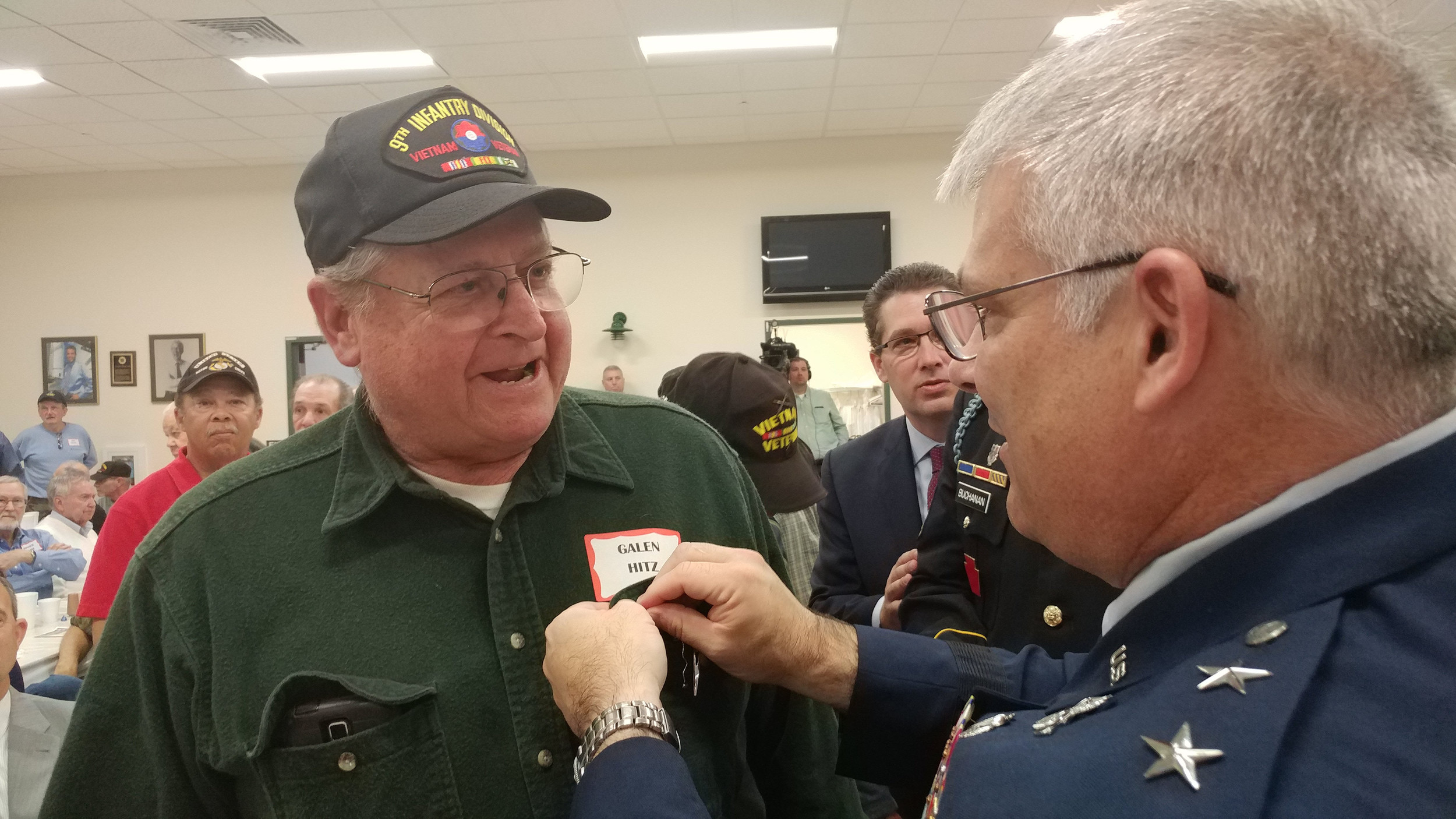 Galen Hitz receives his Vietnam Veteran lapel pin from Major General Anthony Carrelli, Adjutant General of Pennsylvania at the 2017 Veterans breakfast and recognition ceremony Friday, Nov. 3 at the Lower Swatara Fire Department.