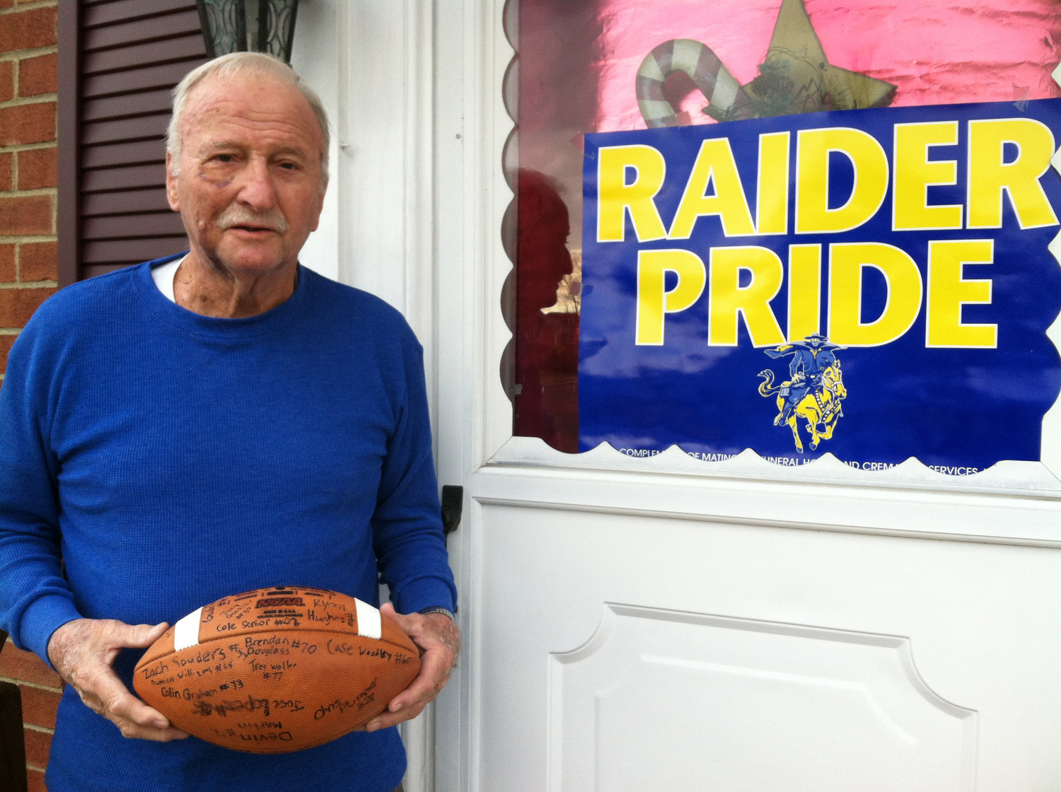 Paul Thompson with his signed football outside the front door to his house at Spruce and Conewago streets.