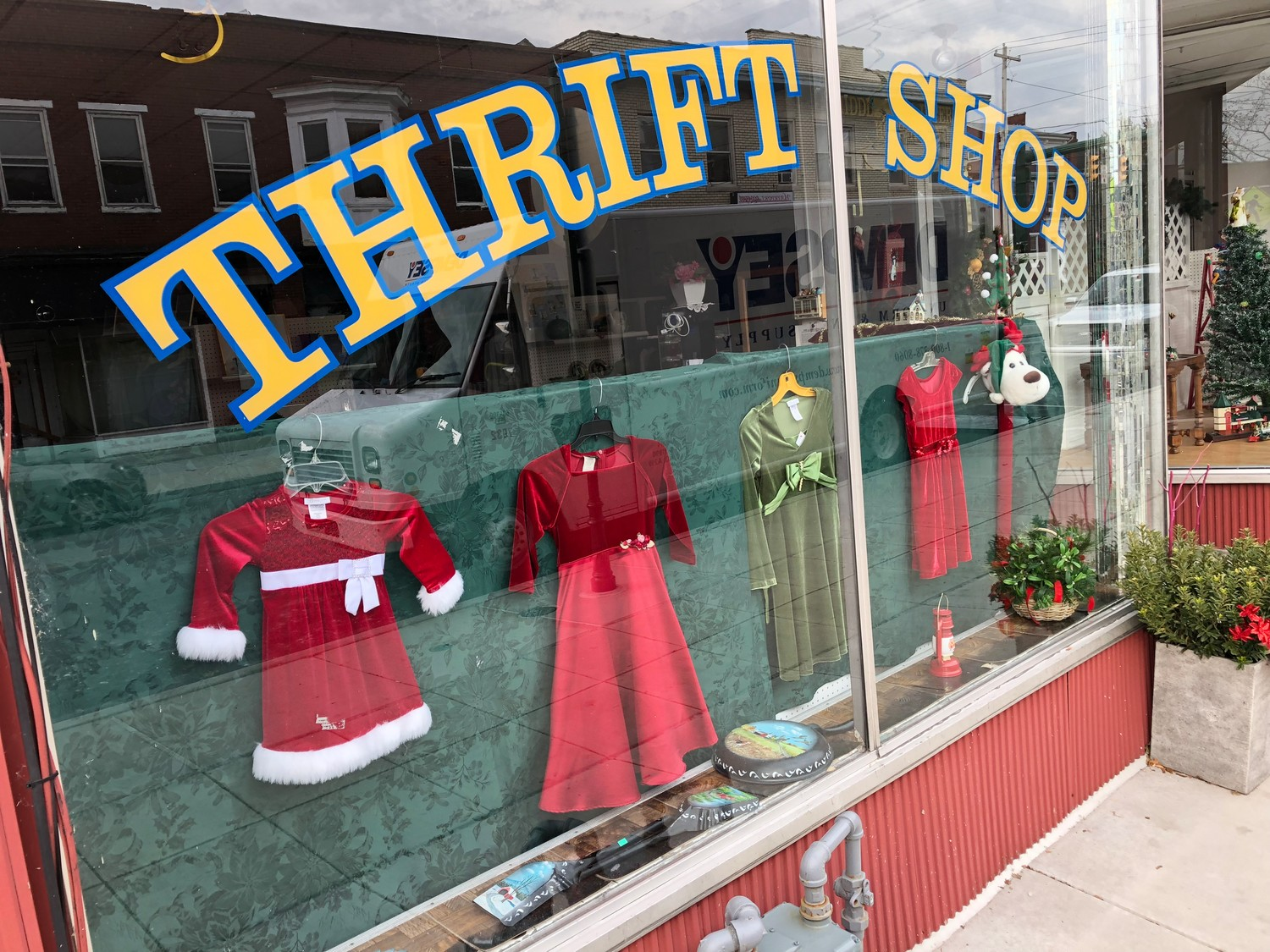 Christmas decorations are evident in the front windows of the Interfaith Senior Service Thrift Shop on South Union Street on Tuesday, but that doesn't mean it's re-opening.